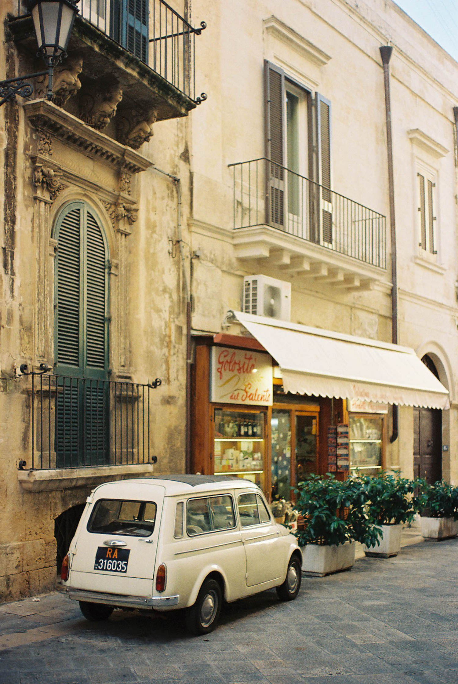 Analogue Travel photograph of vintage Fiat 500, Lecco, Puglia