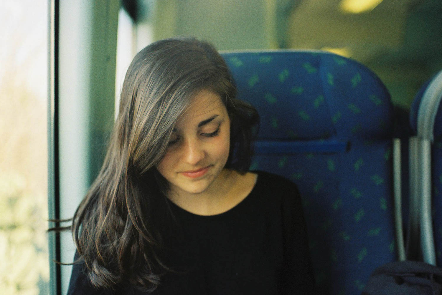 Travel Portrait on the train somewhere in Puglia, while backpacking Italy in the winter