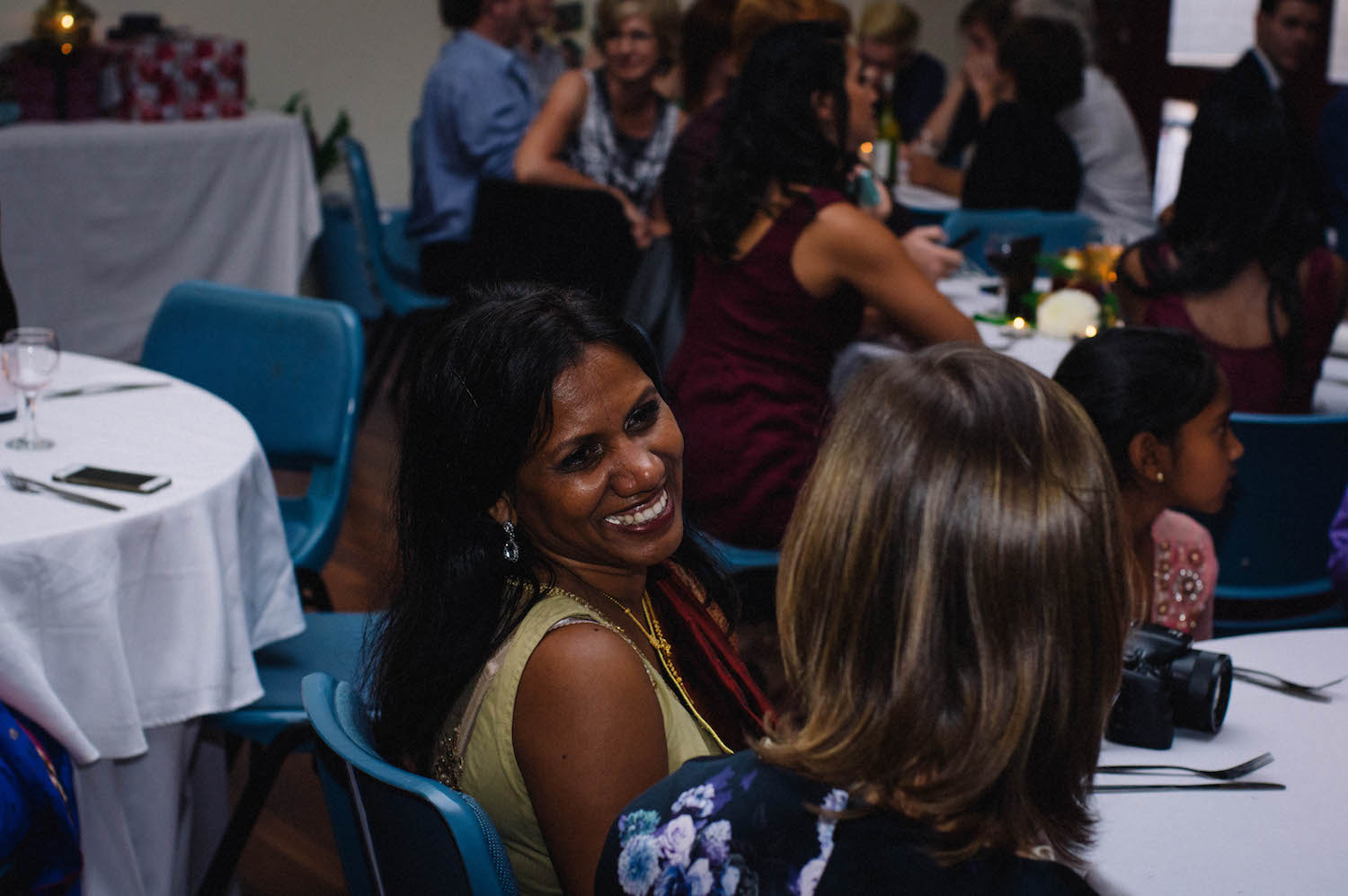 Guests laugh & talk together during a wedding reception at St Matthew's Anglican Church, Subiaco.