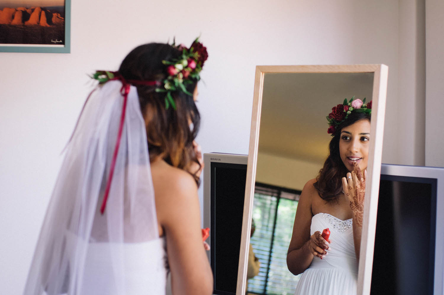 A bride with a veil and flower crown getting ready for her Perth wedding.