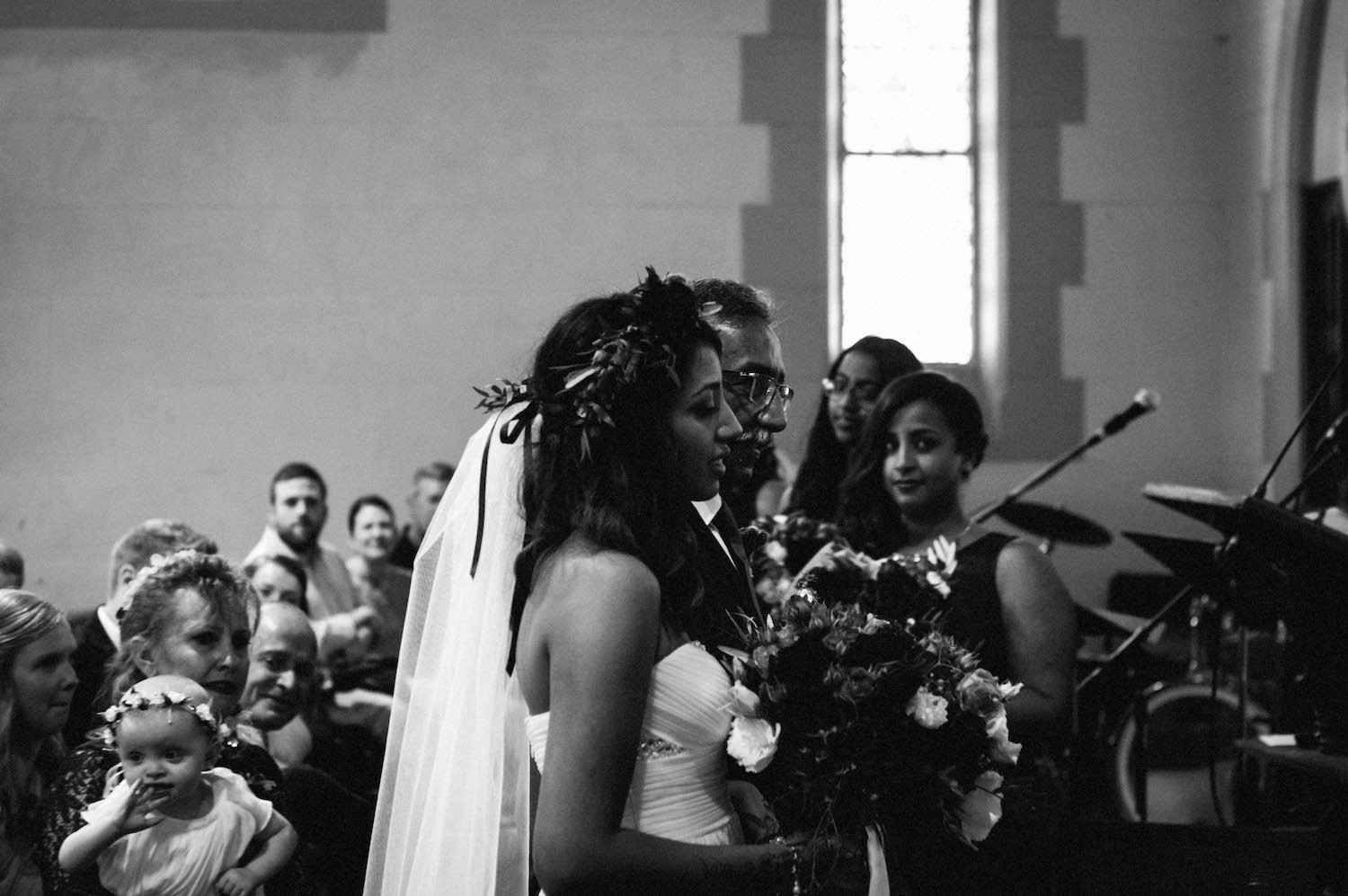 The bride arriving with her Father at the end of the aisle in St Matthew's Church