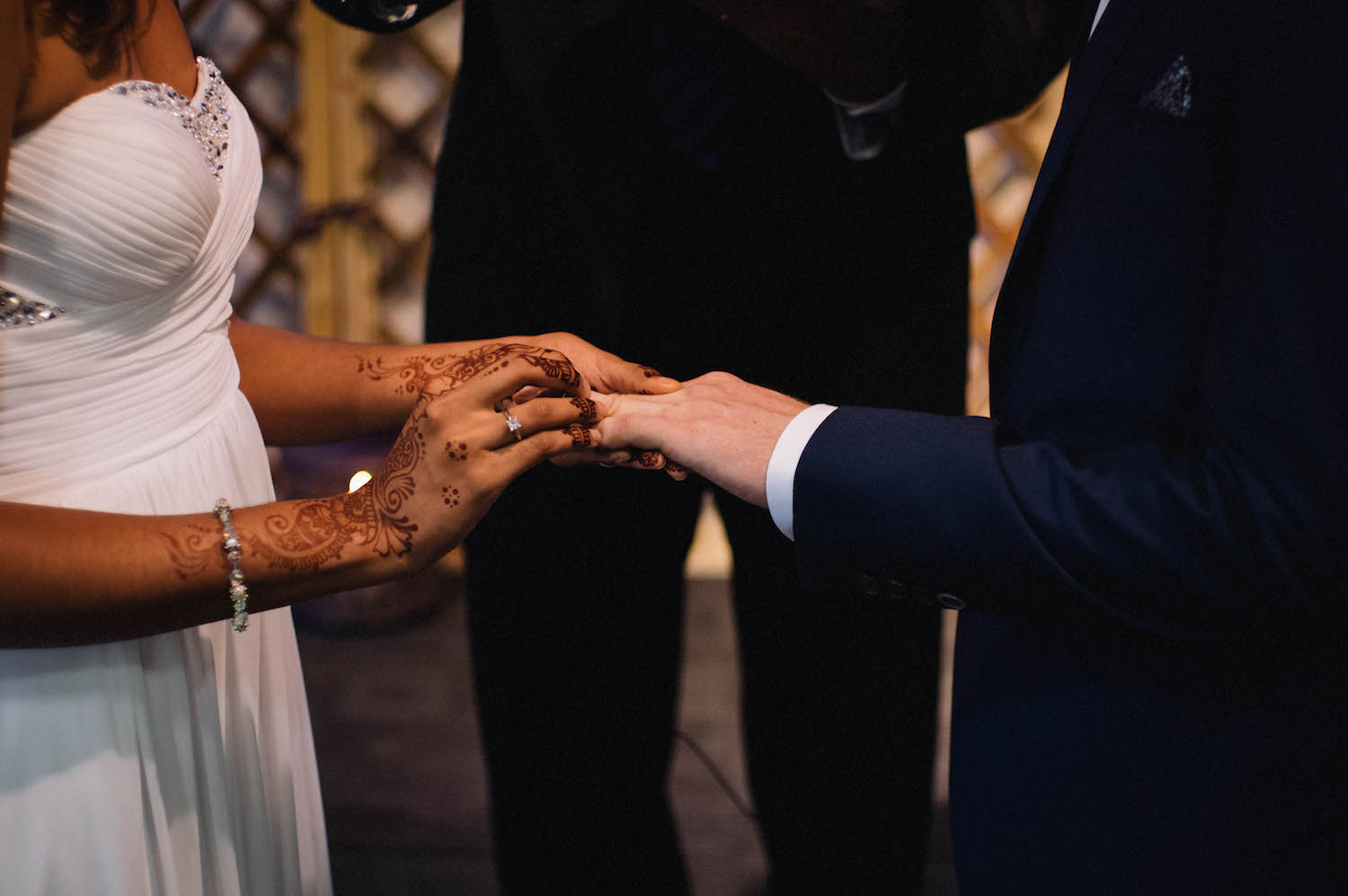 A bride with henna exchanging rings with her new husband at St Matthew's Anglican Church, Subiaco.