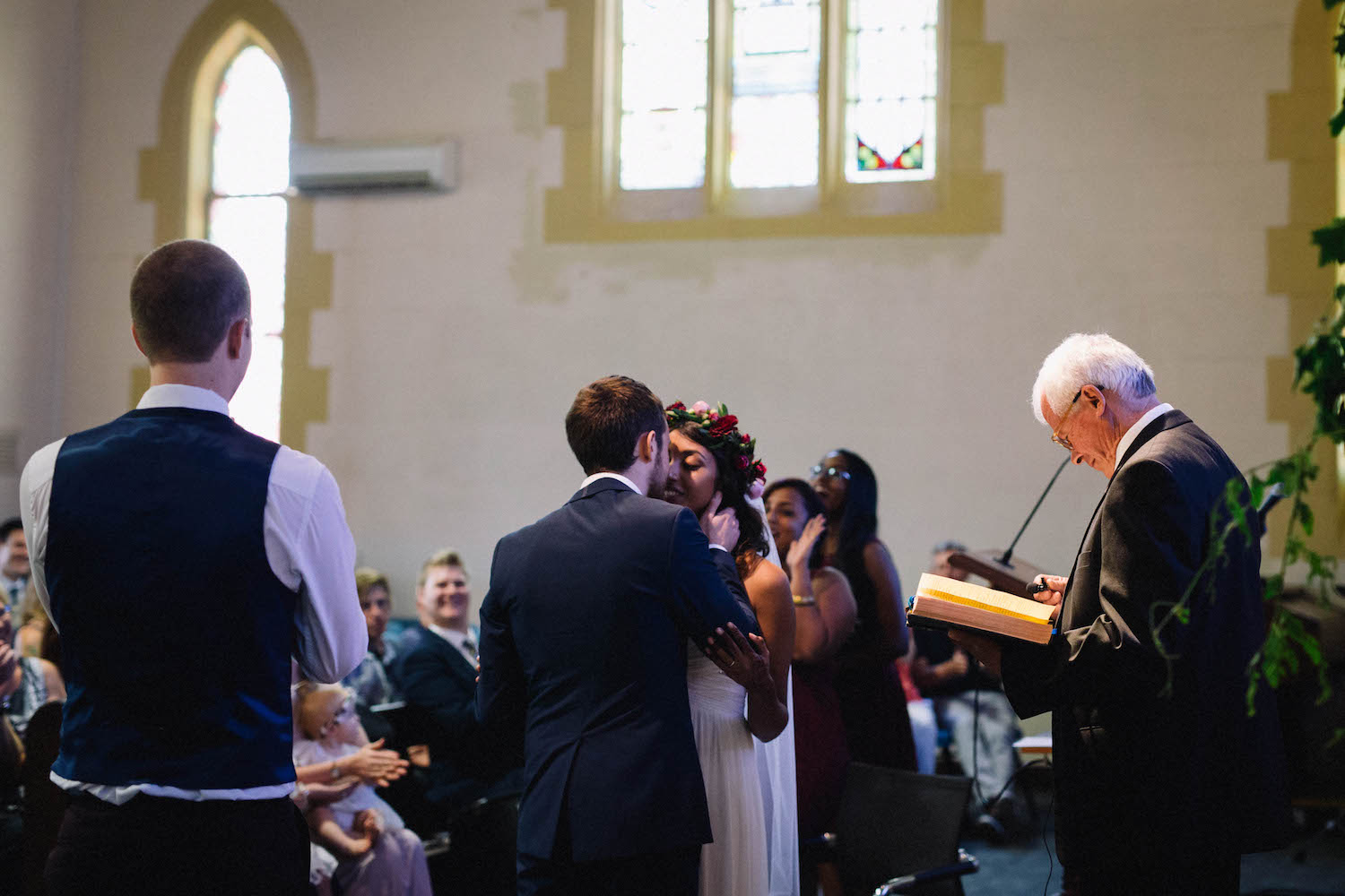 The bride & groom's first kiss at the end of their ceremony at St Matthew's Anglican Church.
