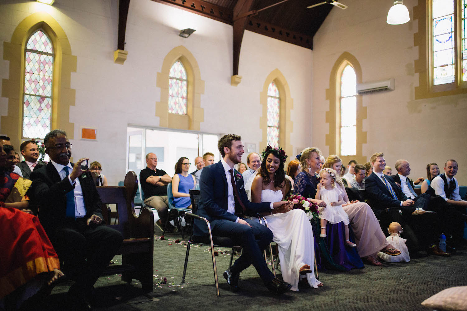 The bride & groom during the sermon after their ceremony at St Matthew's Anglican Church, Perth.