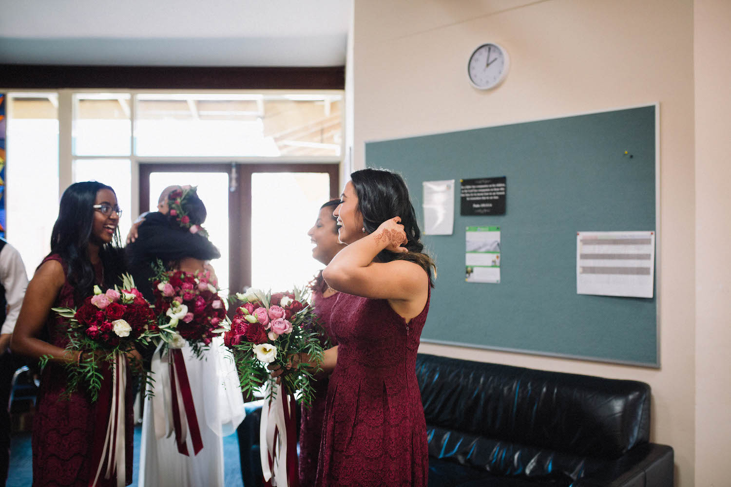 Bridesmaids celebrating after the wedding ceremony at St Matthew's Anglican Church, Subiaco.