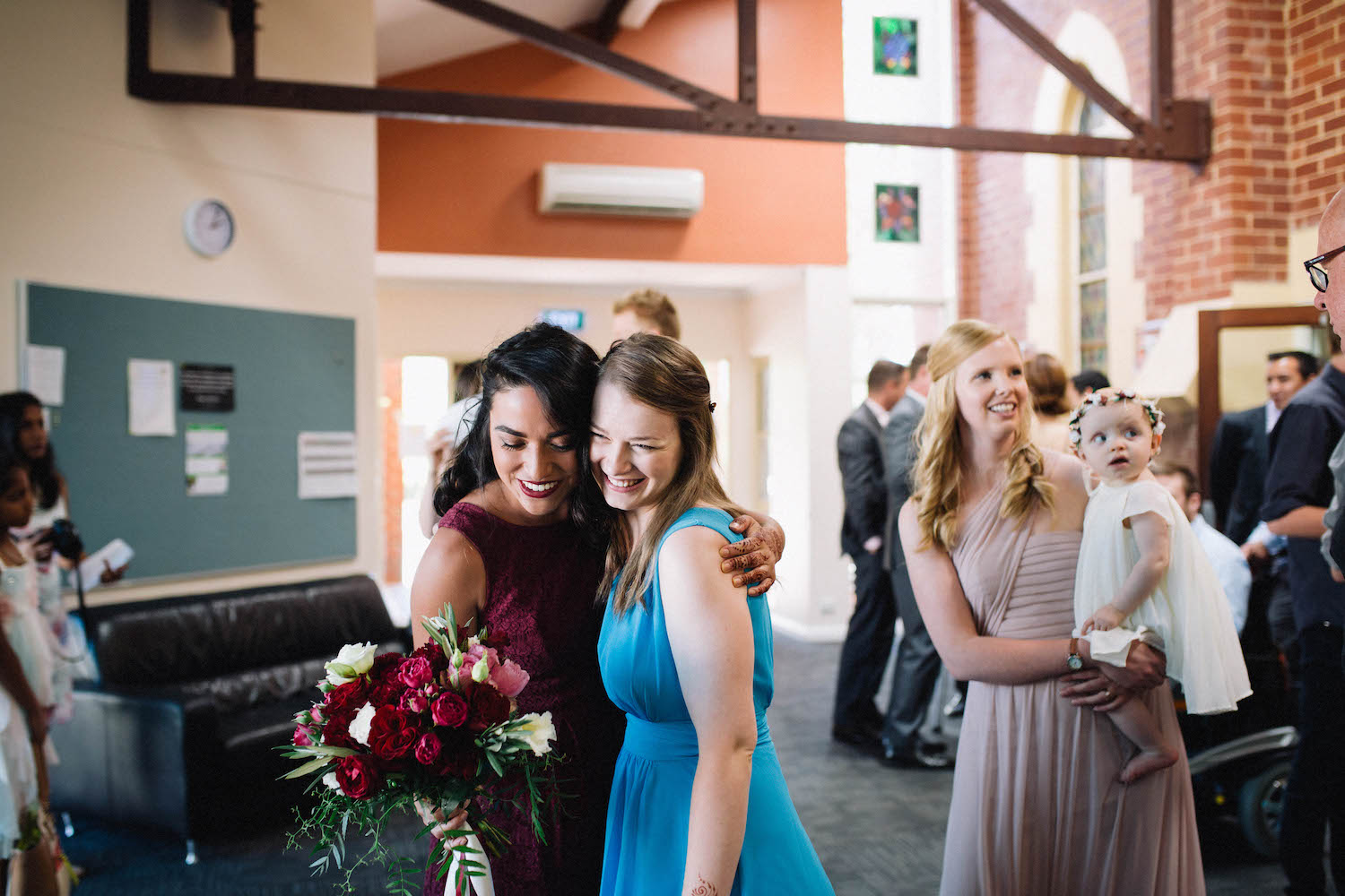 Sisters-in-Law celebrating after a beautiful wedding ceremony at St Matthew's Anglican Church