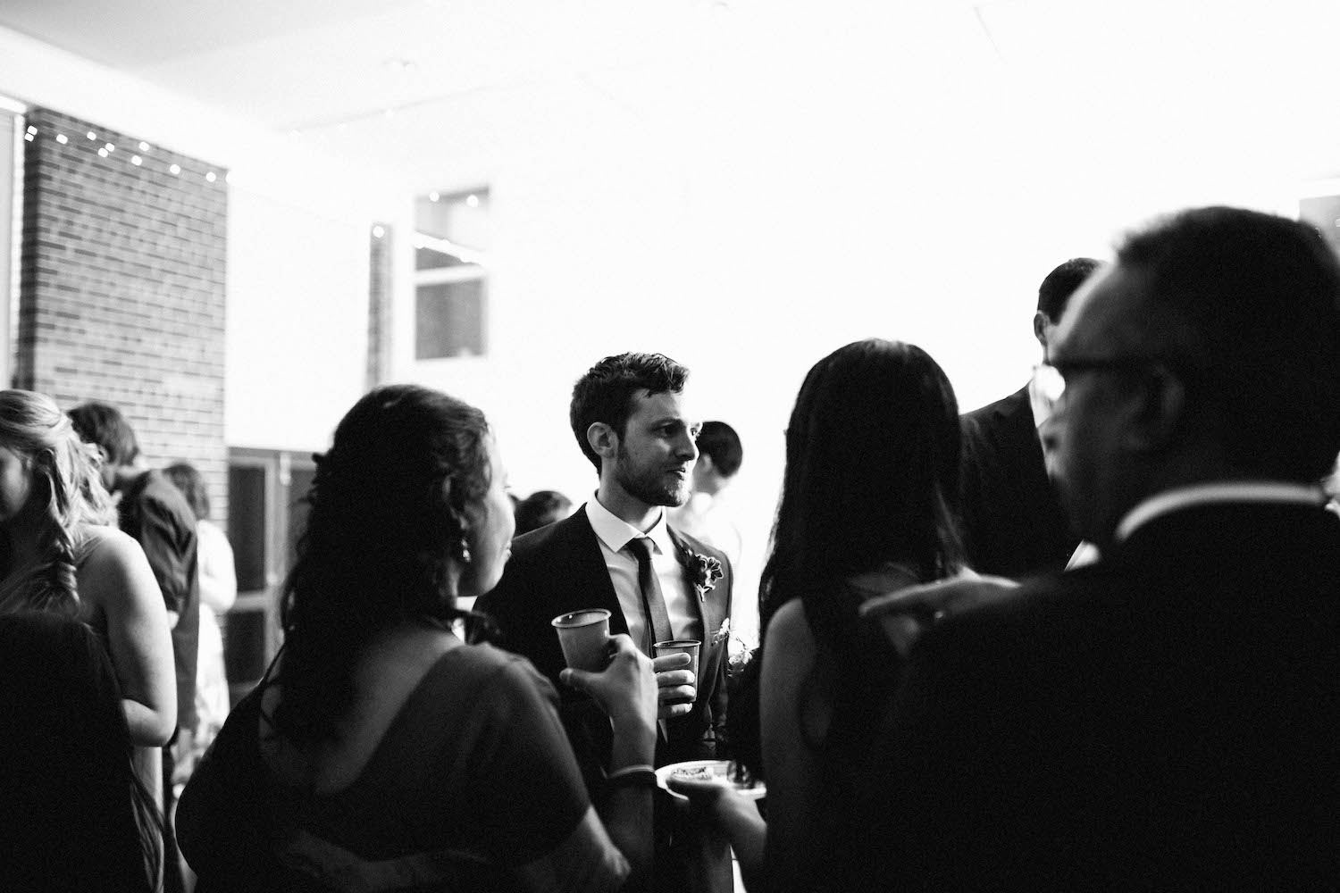 The groom chatting with guests after his Subiaco Wedding ceremony at St Matthew's Anglican Church.