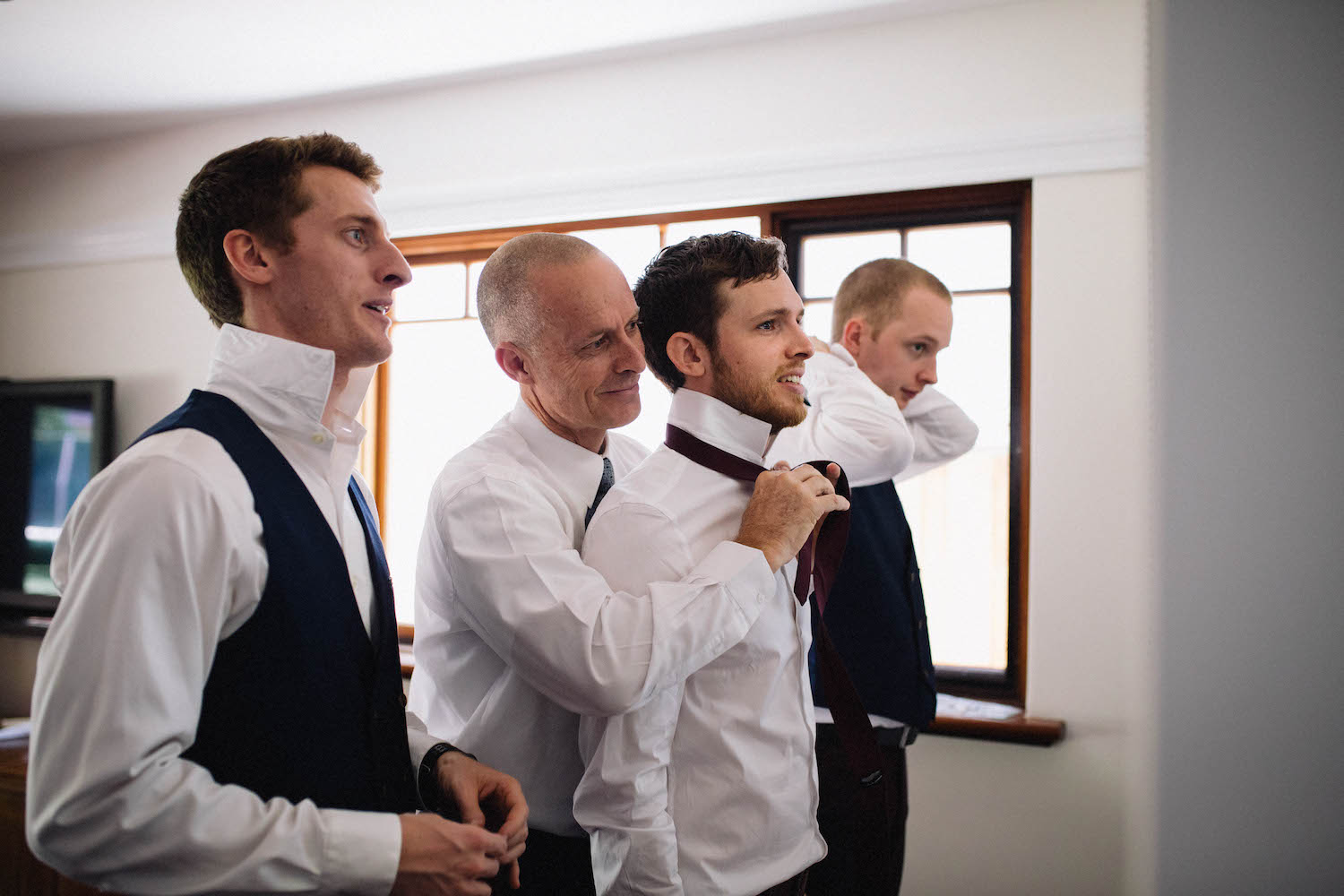 Jibb's Dad & brothers tying his tie the morning of his Subiaco wedding.