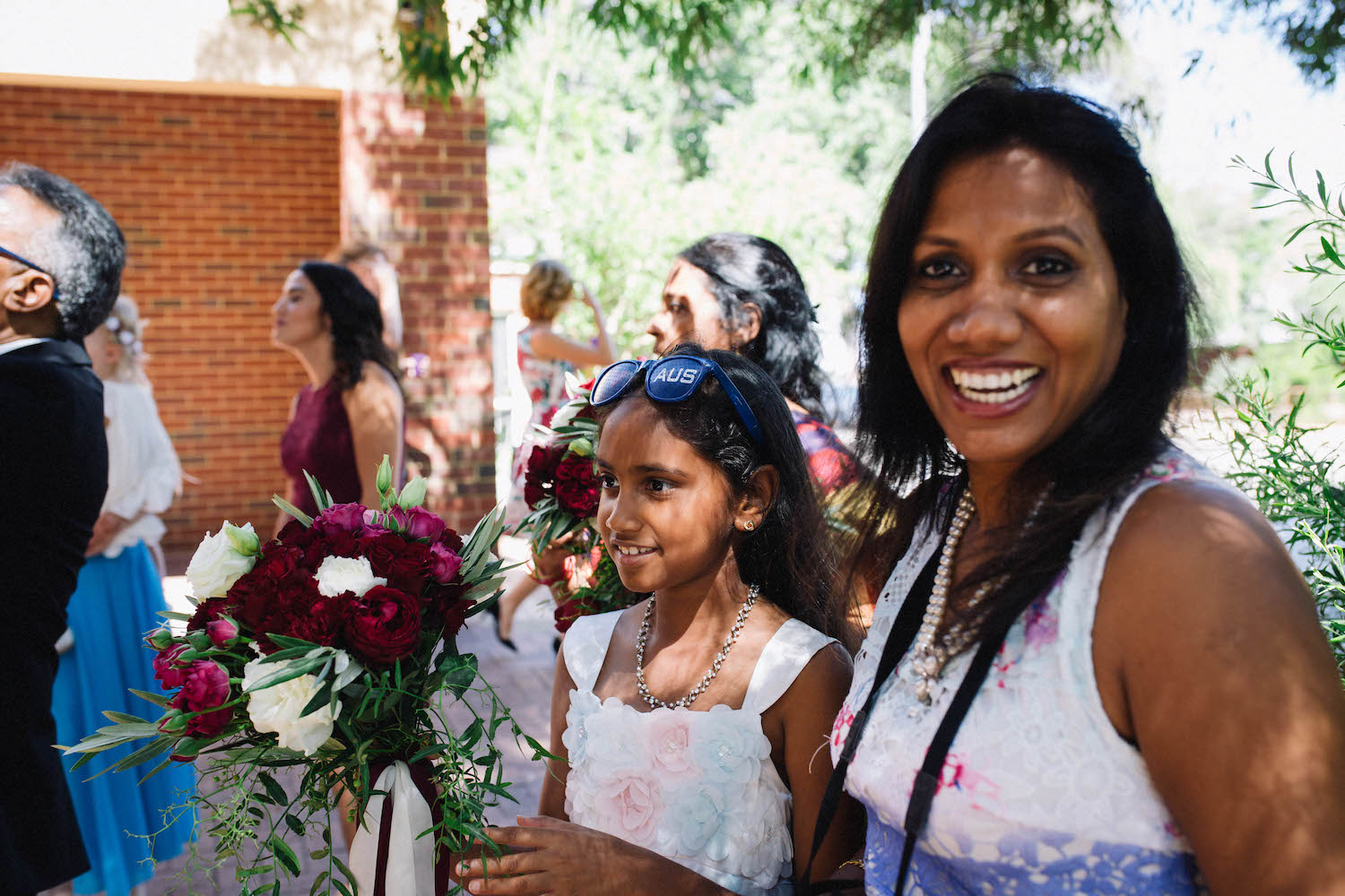 Family of the bride celebrating outside St Matthew's Anglican Church, Subiaco, after the Wedding Ceremony.