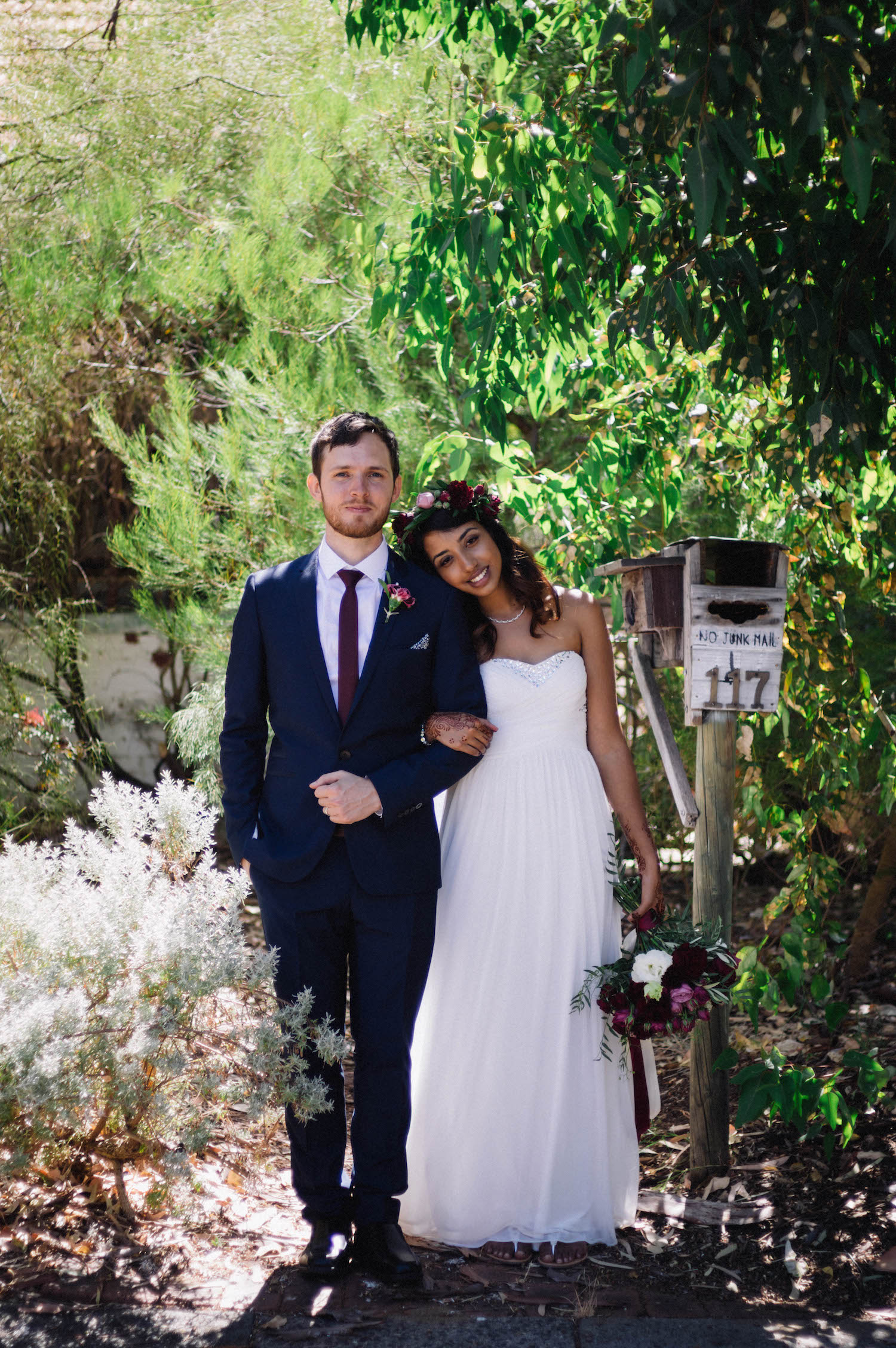 The bride & groom standing together during their wedding portraits in suburban Subiaco, Australia, taken by Rhianna May Destination Wedding Photographer