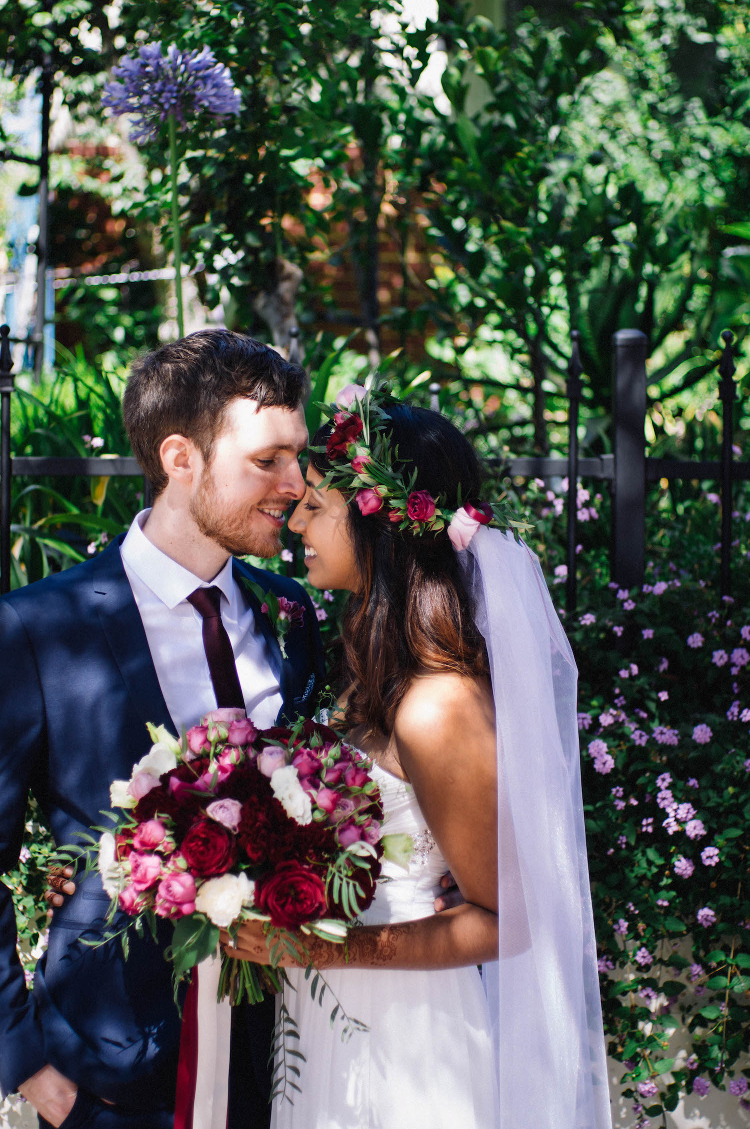 Jibb & Tripthi share a moment on a Subiaco street in dappled light taken by Rhianna May Destination Wedding Photographer