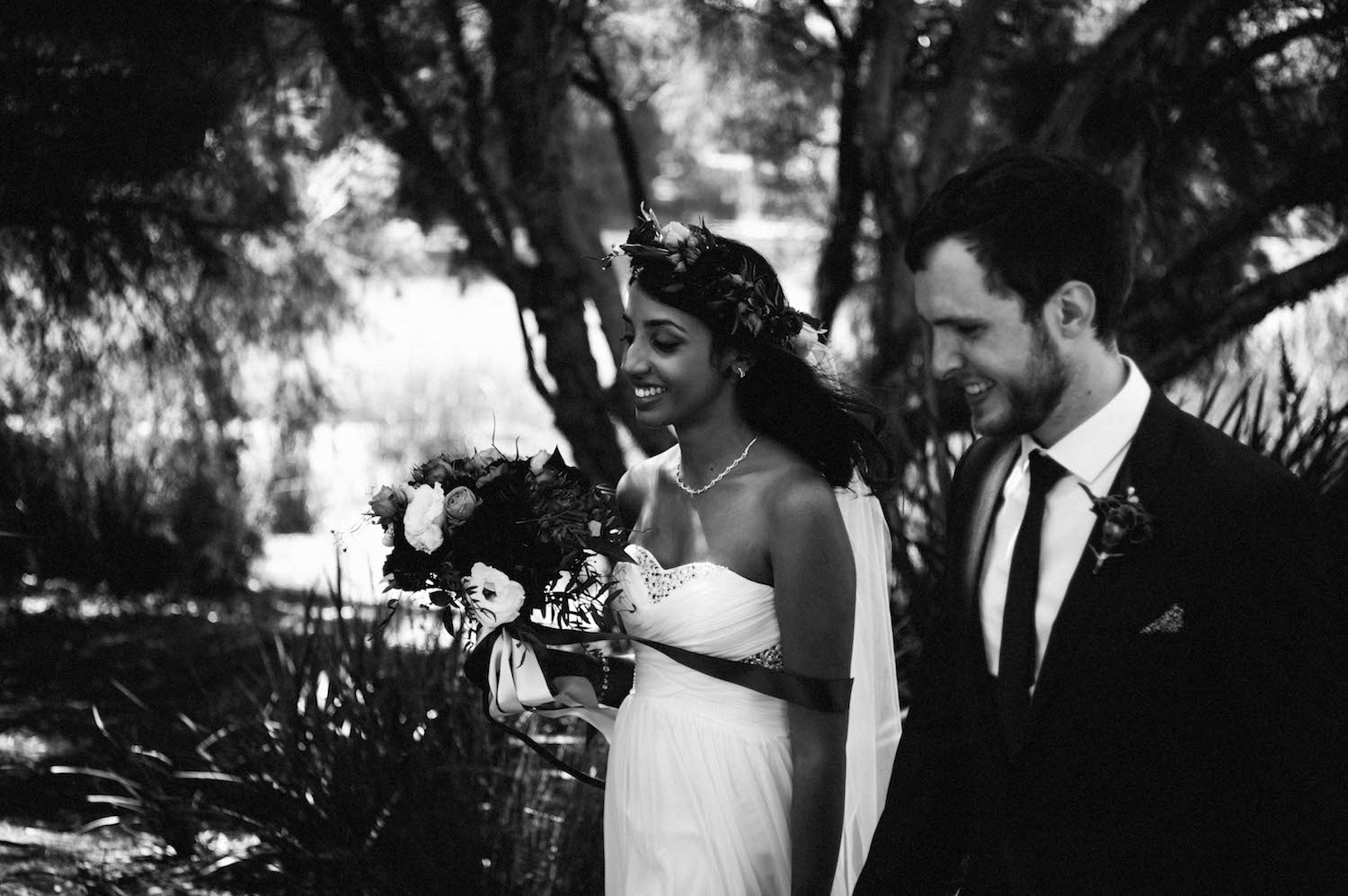 A black & white photo of Jibb & Tripthi celebrating their wedding together at Shenton Park.