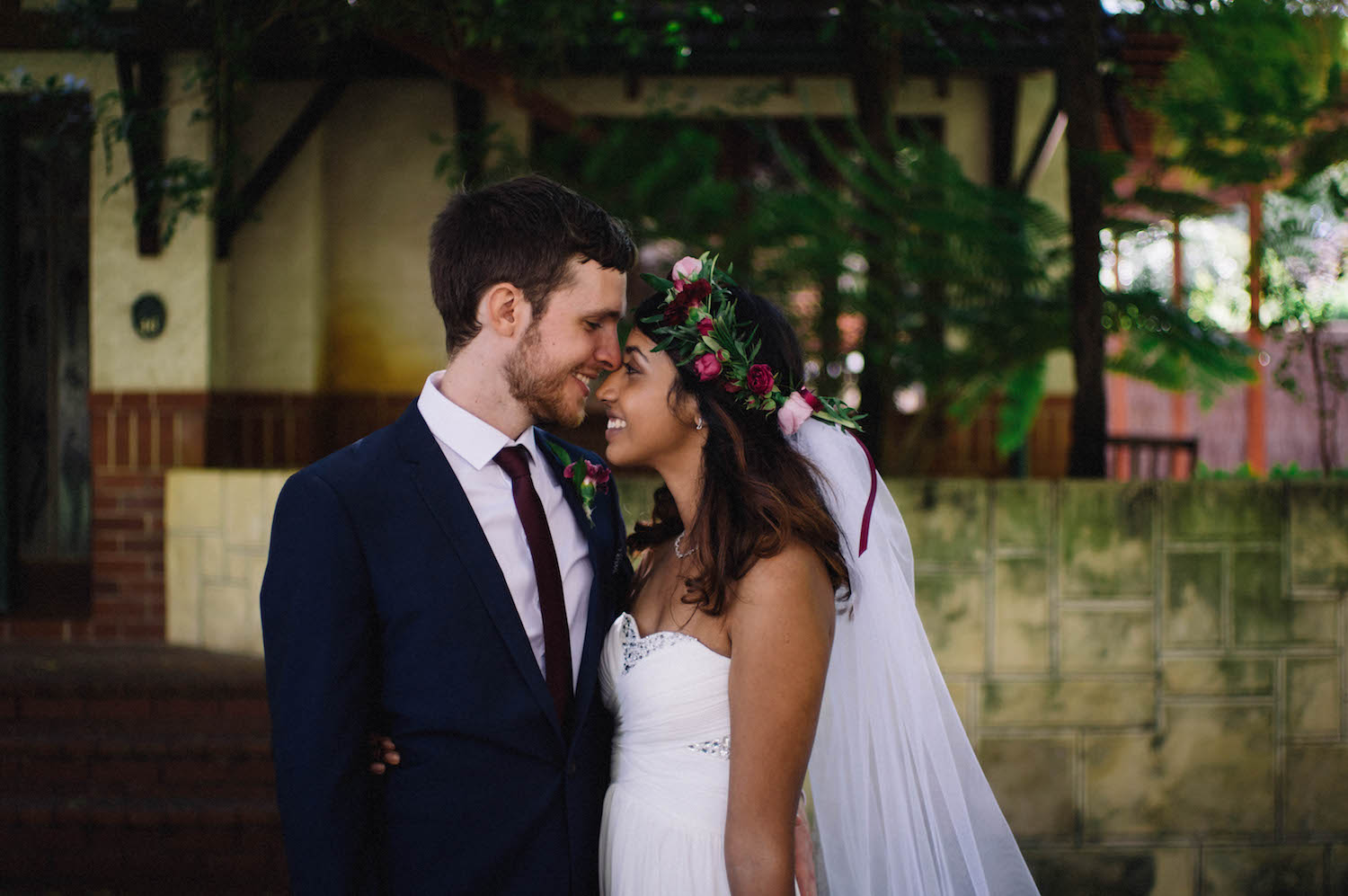 A bride & groom share a moment in Subiaco's Suburbs, photographed by Rhianna May Wedding Photographer.