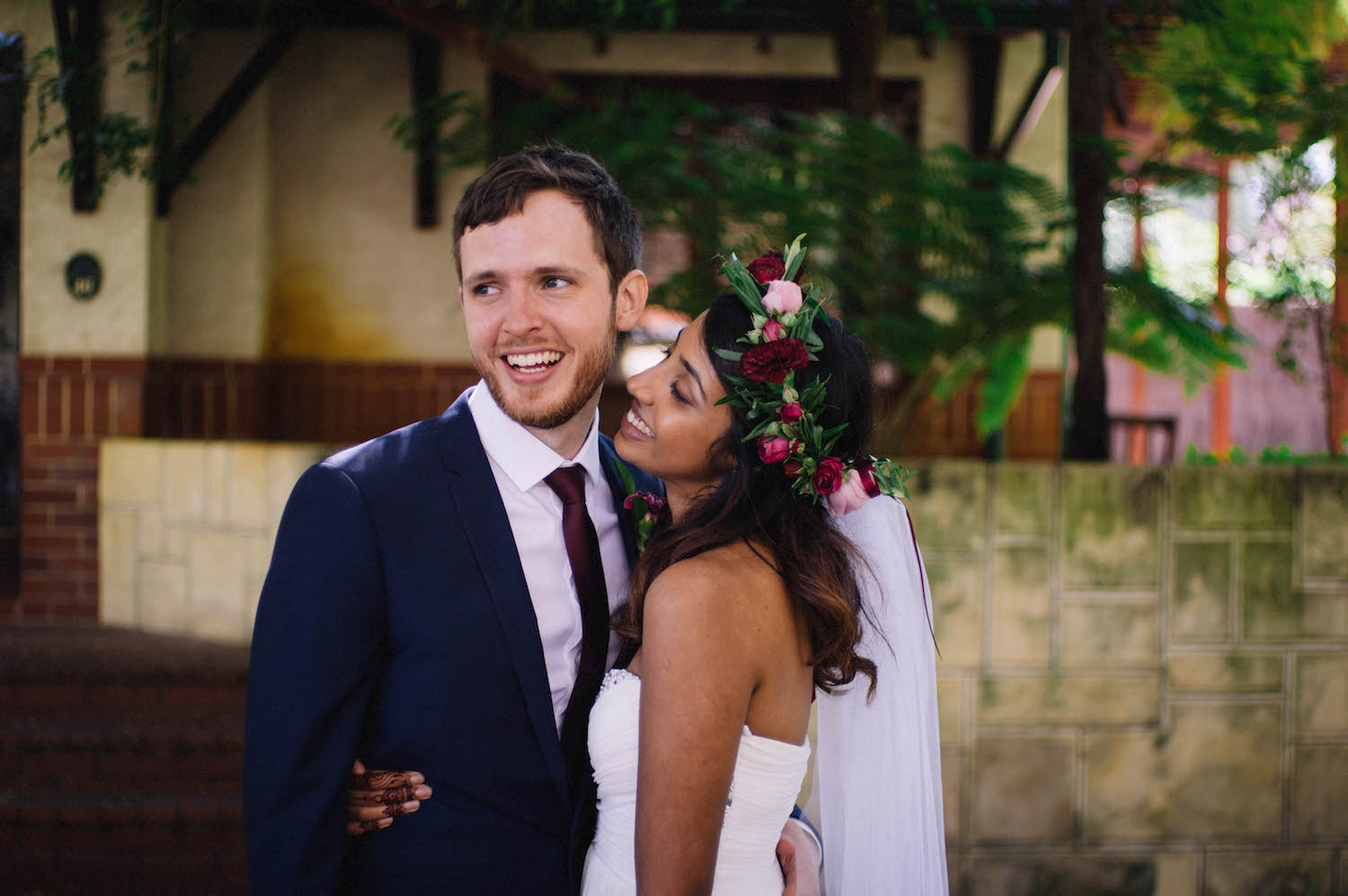 Jibb & Tripthi laugh together during their wedding portrait session in Subiaco, captured by Rhianna May Destination Wedding Photographer.