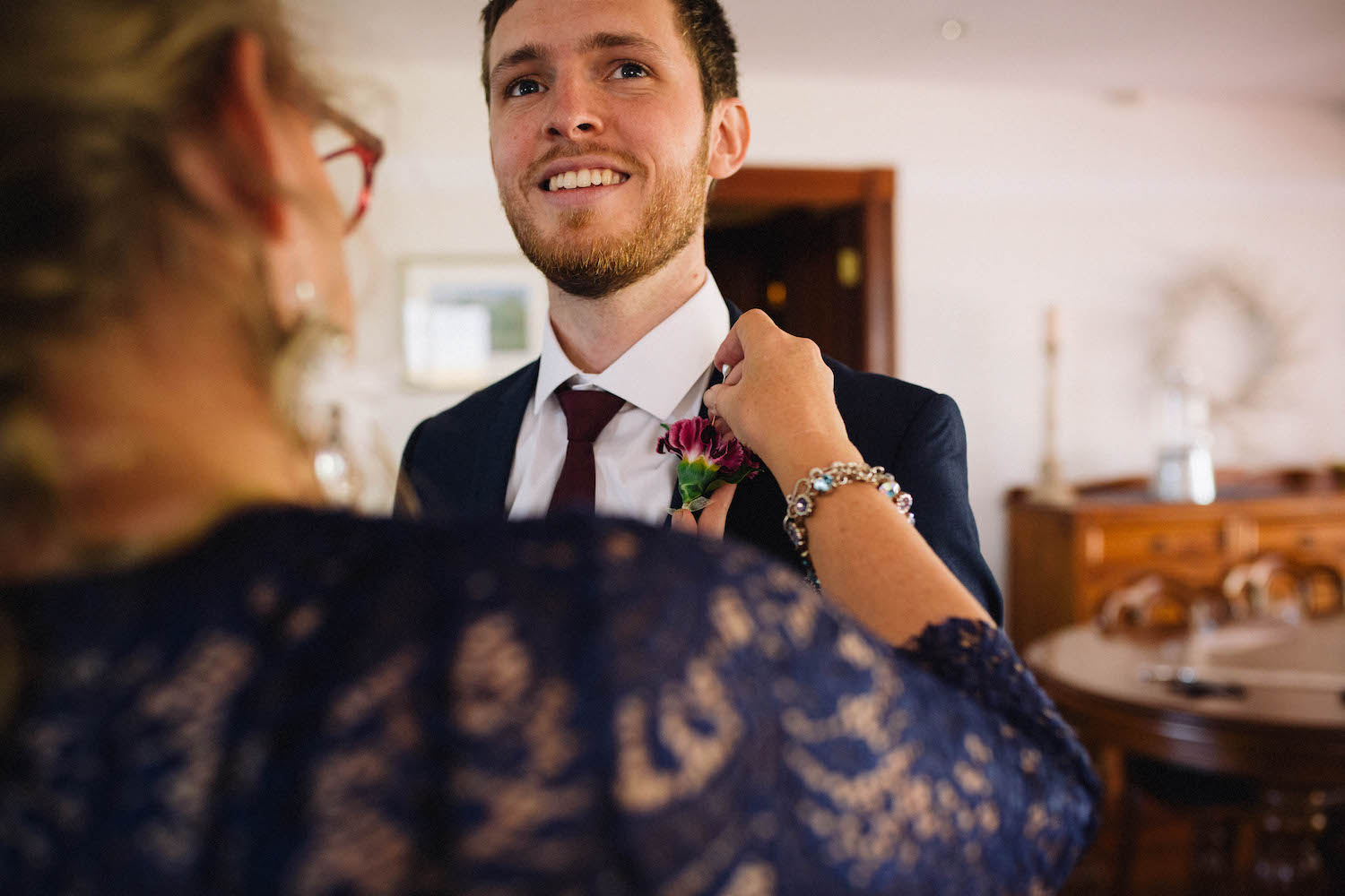 The groom's Mum fixing his buttonhole the morning of his Subiaco wedding.