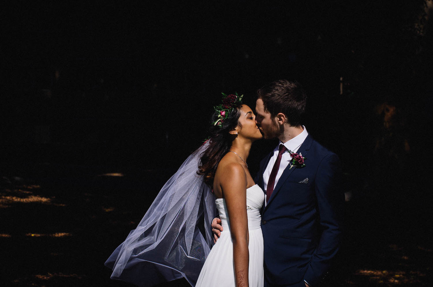 A Bride & Groom under Perth's harsh summer light at their January Subiaco wedding, photo taken by Rhianna May Destination Wedding Photographer