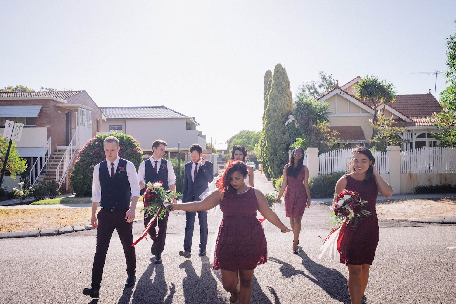 Candid bridal party portrait taken in Perth's suburbs by Rhianna May Wedding Photography