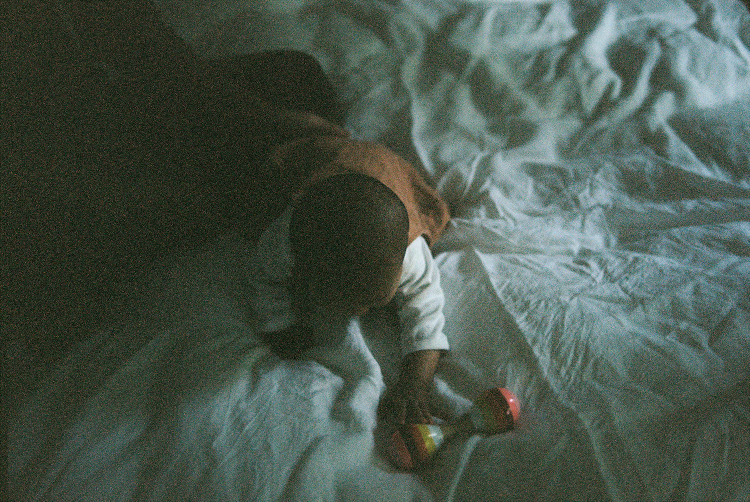 Baby Alexa playing with her rattle, as photographed at her home, on film in Perth.