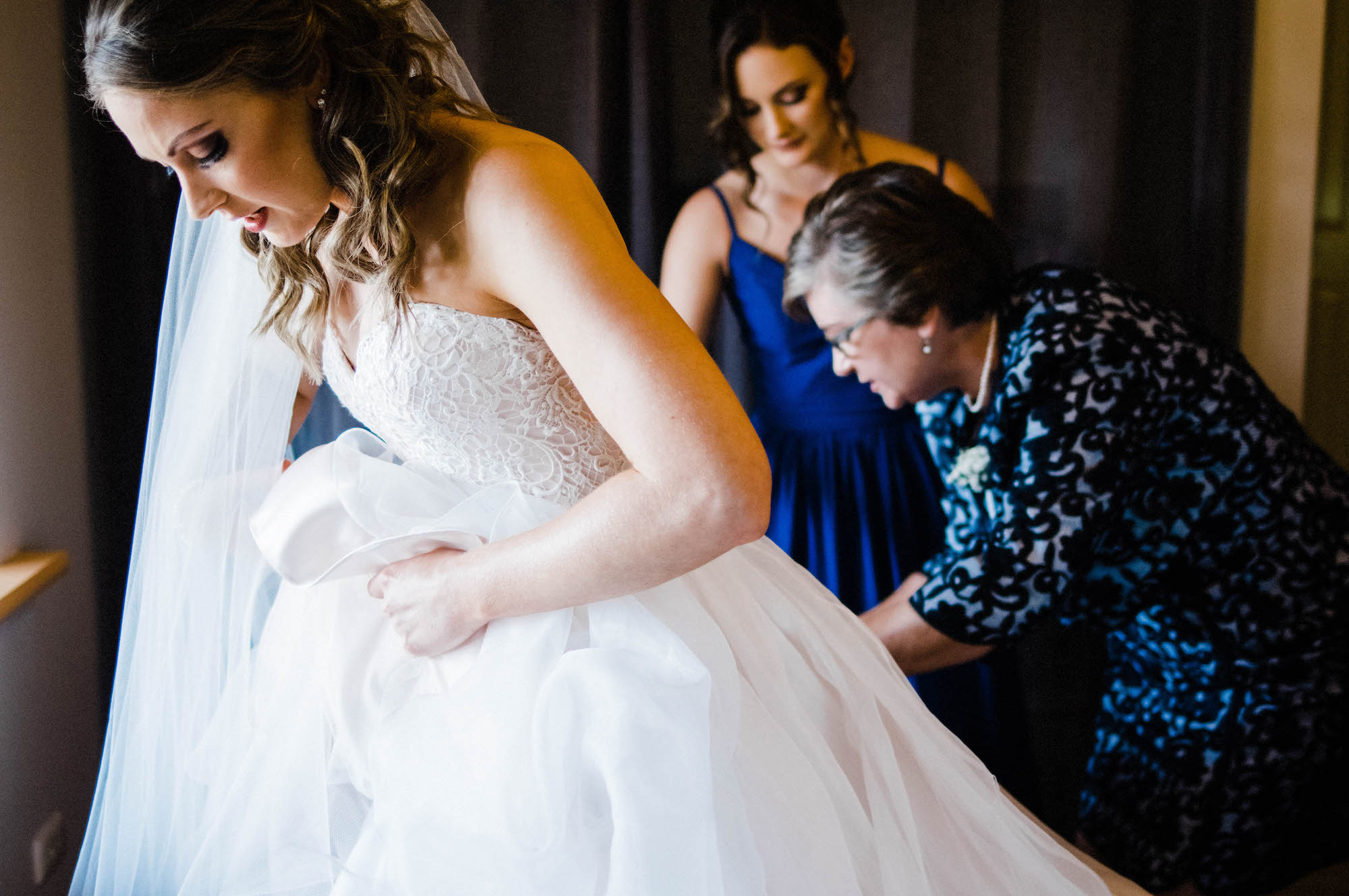 The bride getting dressed at home the morning of her Byford wedding.
