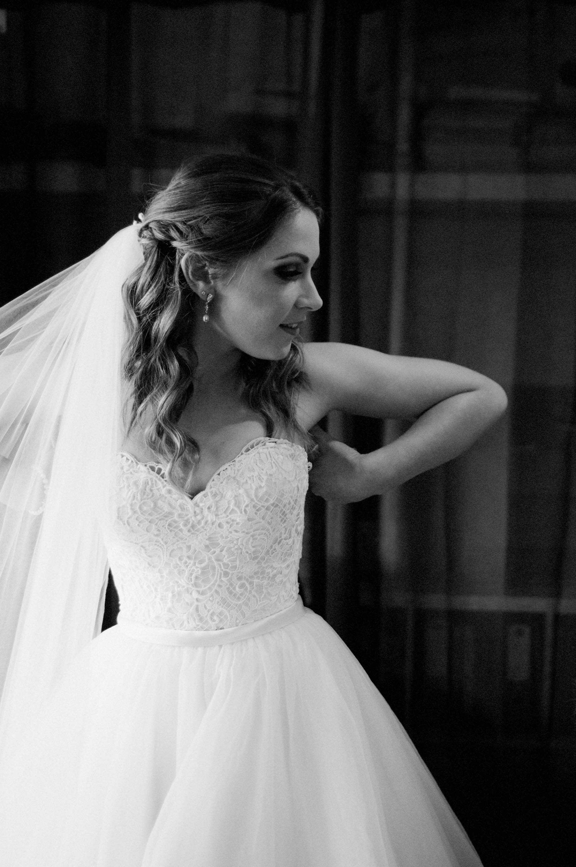 The bride making final adjustments before she leaves for her Quarry Farm ceremony.