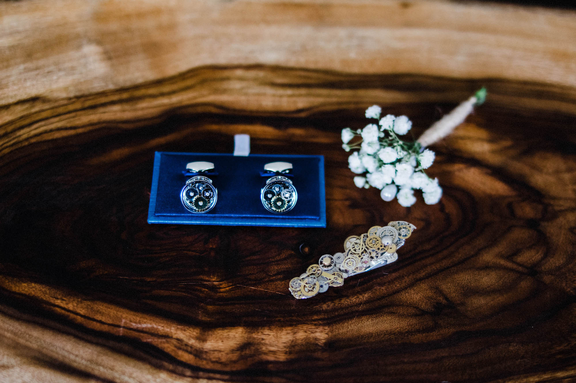 An image of the groom's preparation details, including a tie pin, button hole and cuff links.