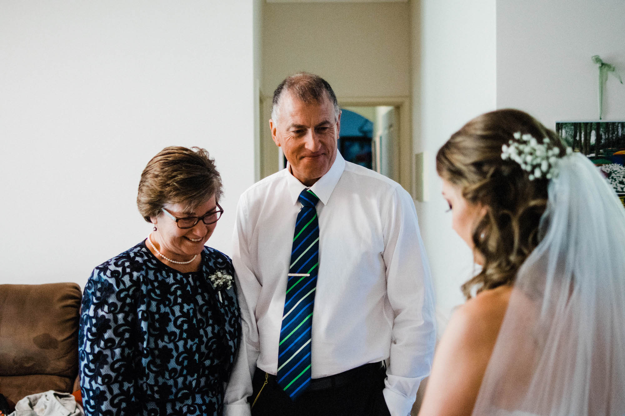 The parent's of the bride seeing her in her dress, ready to go to her Quarry Farm ceremony.