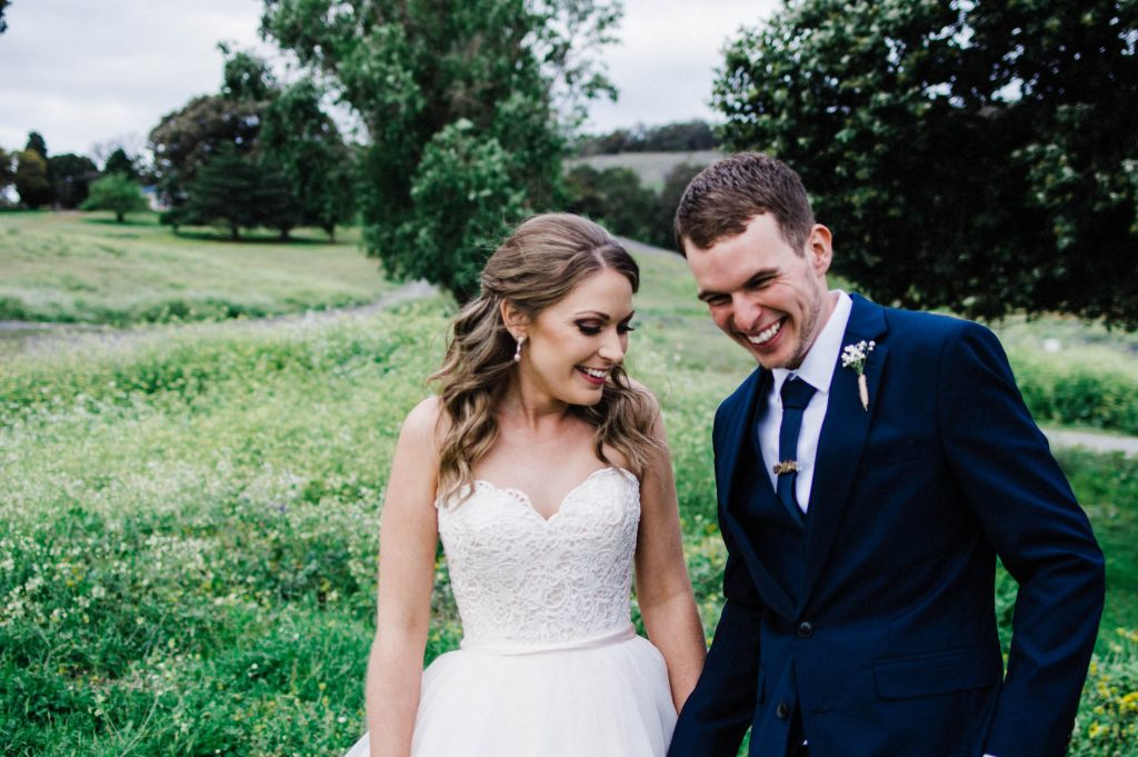 The bride & groom smile together during their wedding portraits in Byford, Australia.