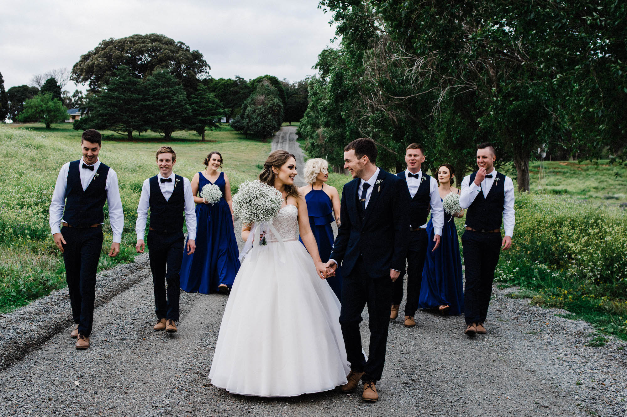 Authentic wedding photography of the bridal party walking together at Quarry Farm, Western Australia.