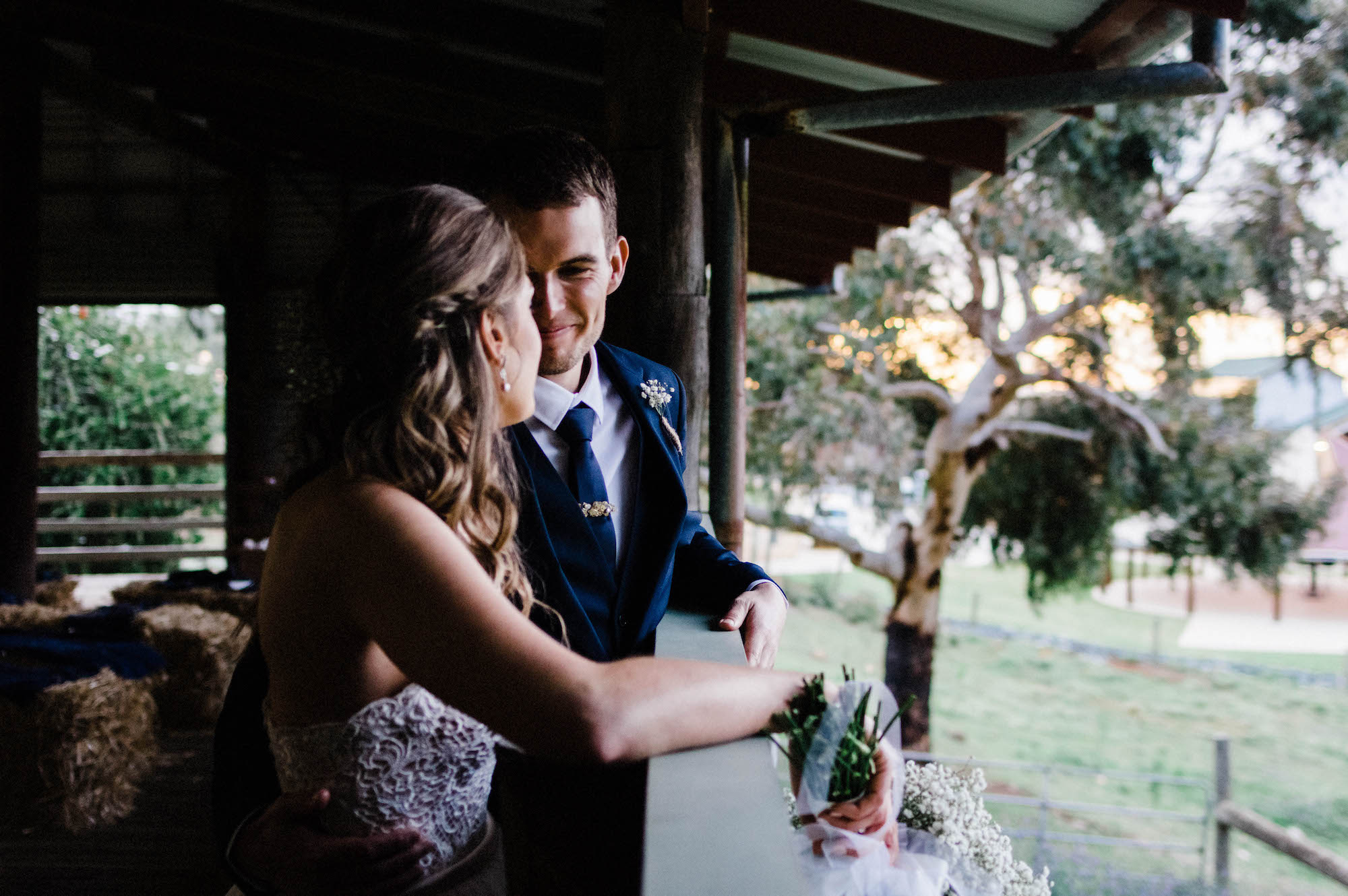 The bride & groom share a quiet moment in the shearing shed, Western Australia.