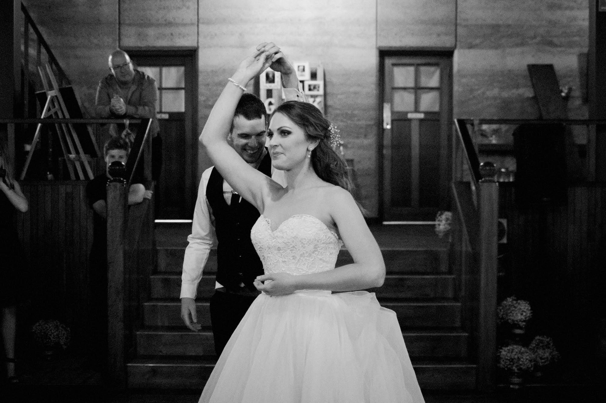 A black & white wedding photo of the bride & groom during their first dance at Quarry Farm WA.