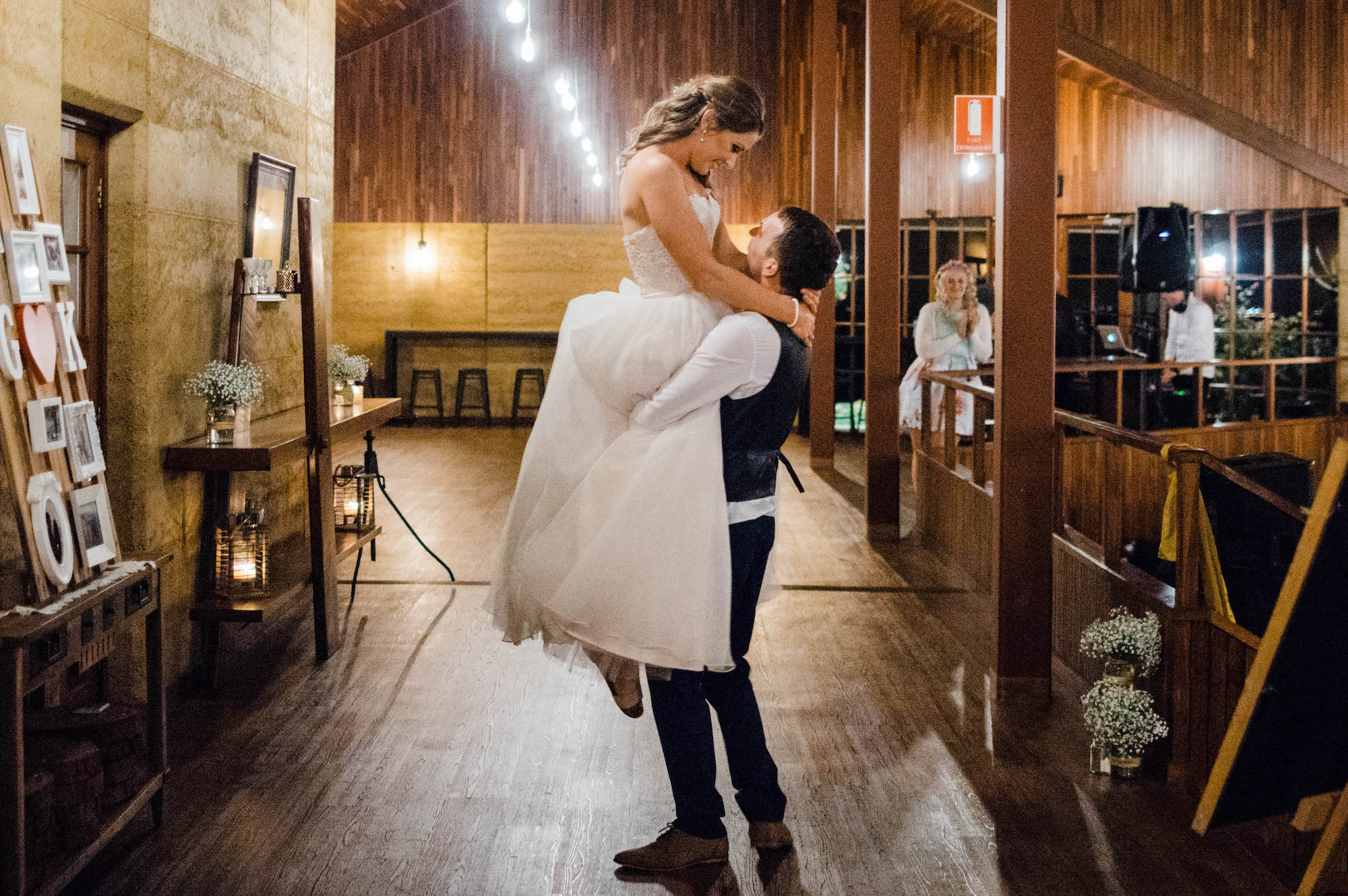 The groom lifts the bride during their first dance at Quarry Farm.