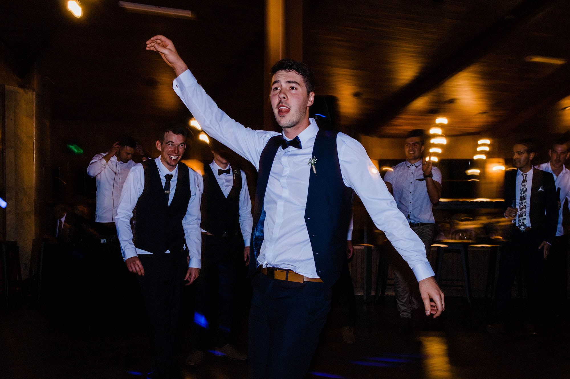 A groomsman dances at a Quarry Farm wedding reception.
