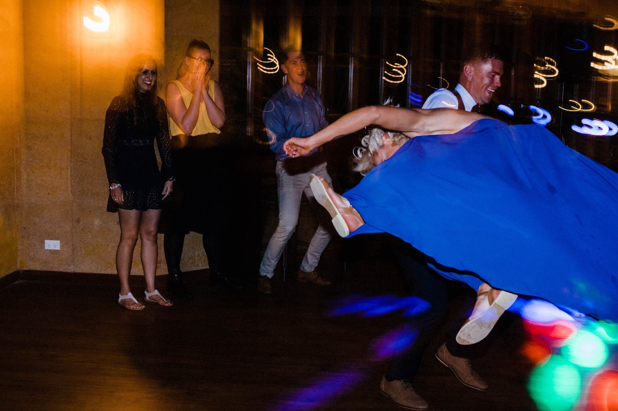 Guests pull some crazy dance moves at a Quarry Farm wedding reception.