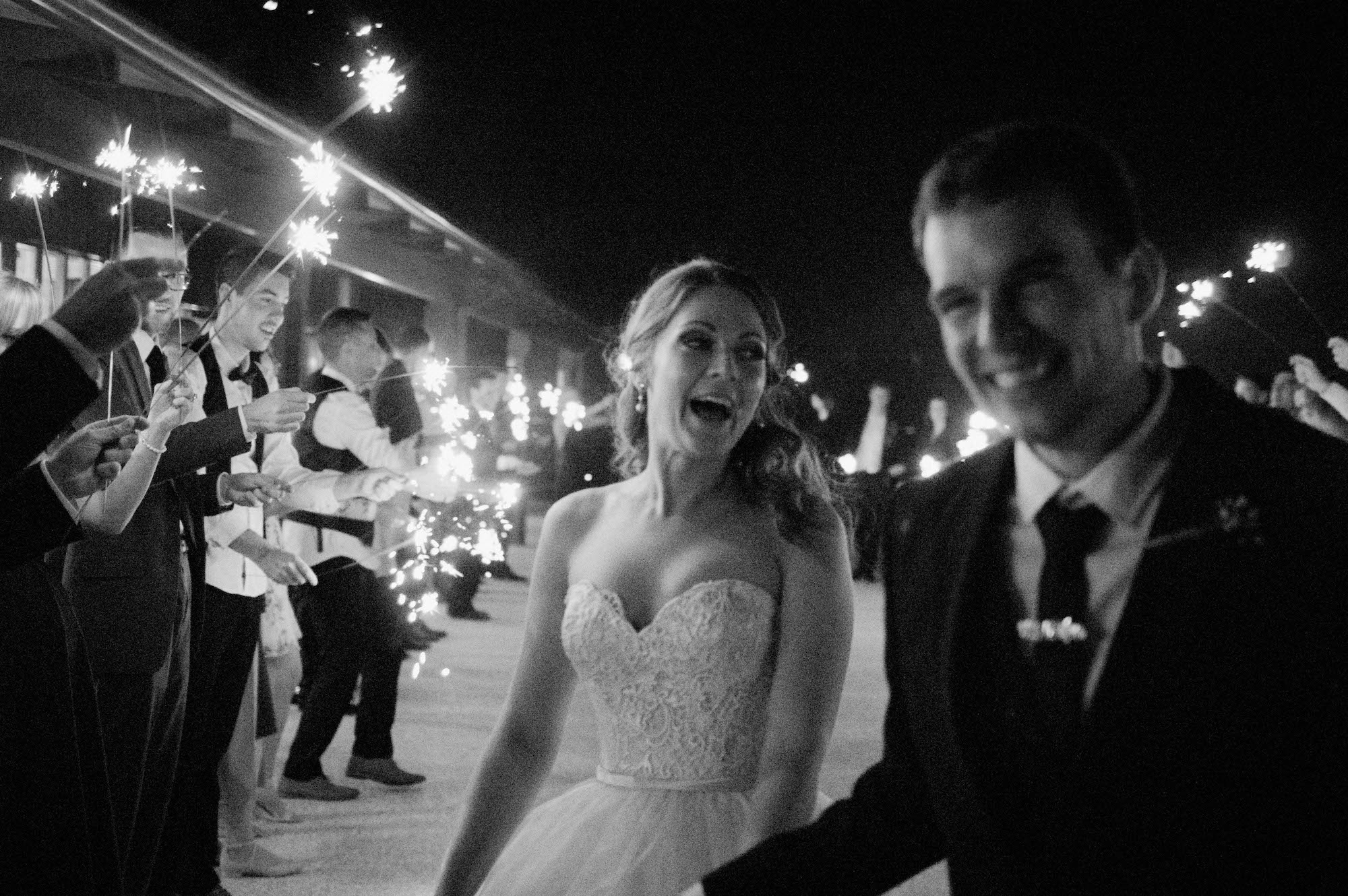 Black & white Quarry Farm wedding photography of a sparkler exit.