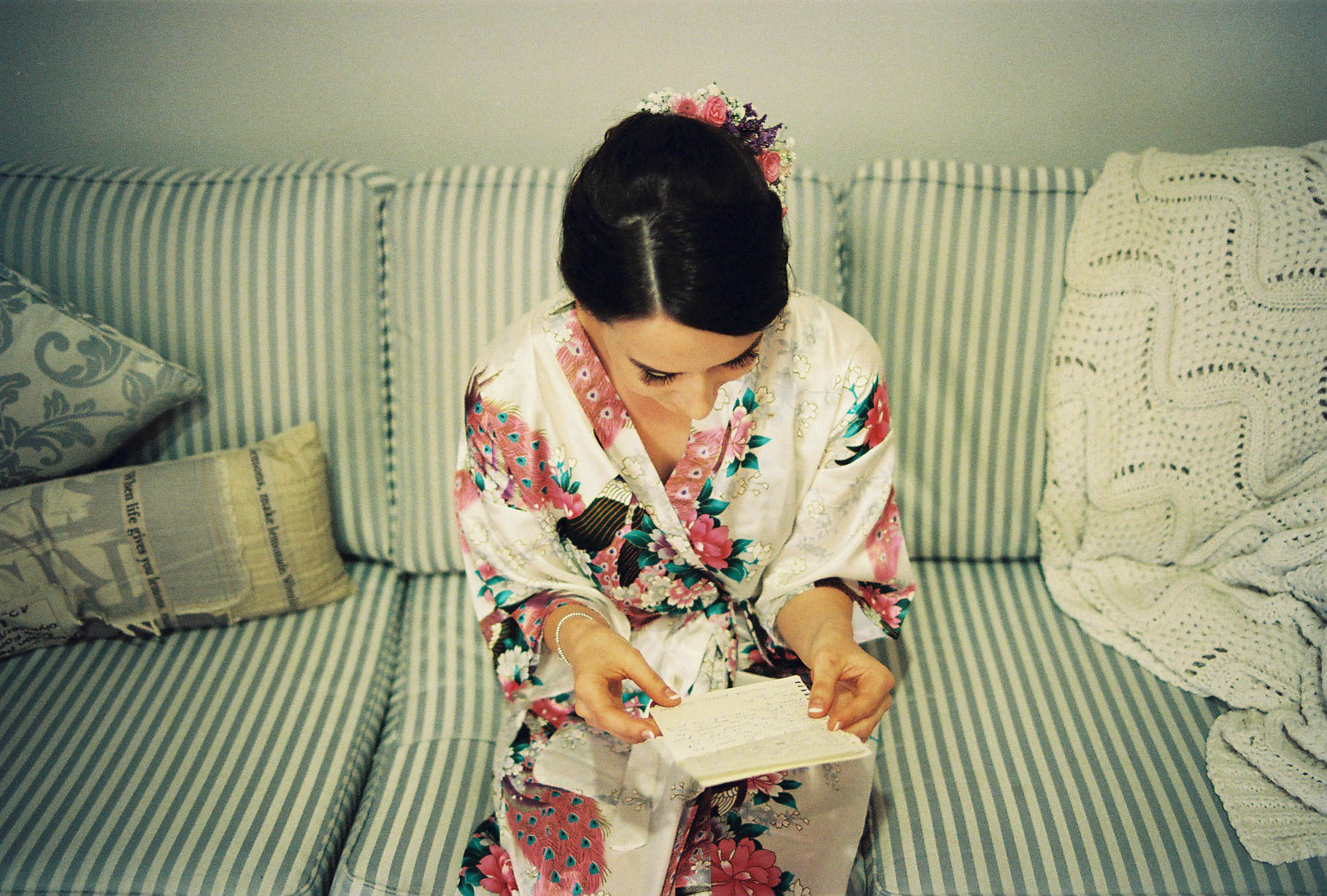 A photo of the bride reading a letter from the groom the morning of her wedding in the South West
