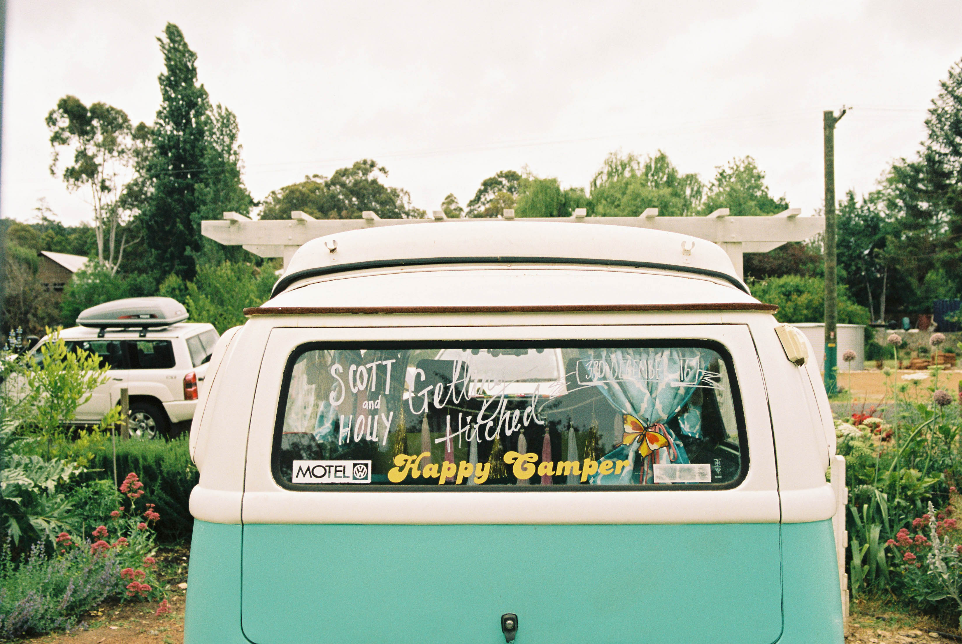 A photo of the back of a blue and white Kombi van the morning of a South West Wedding