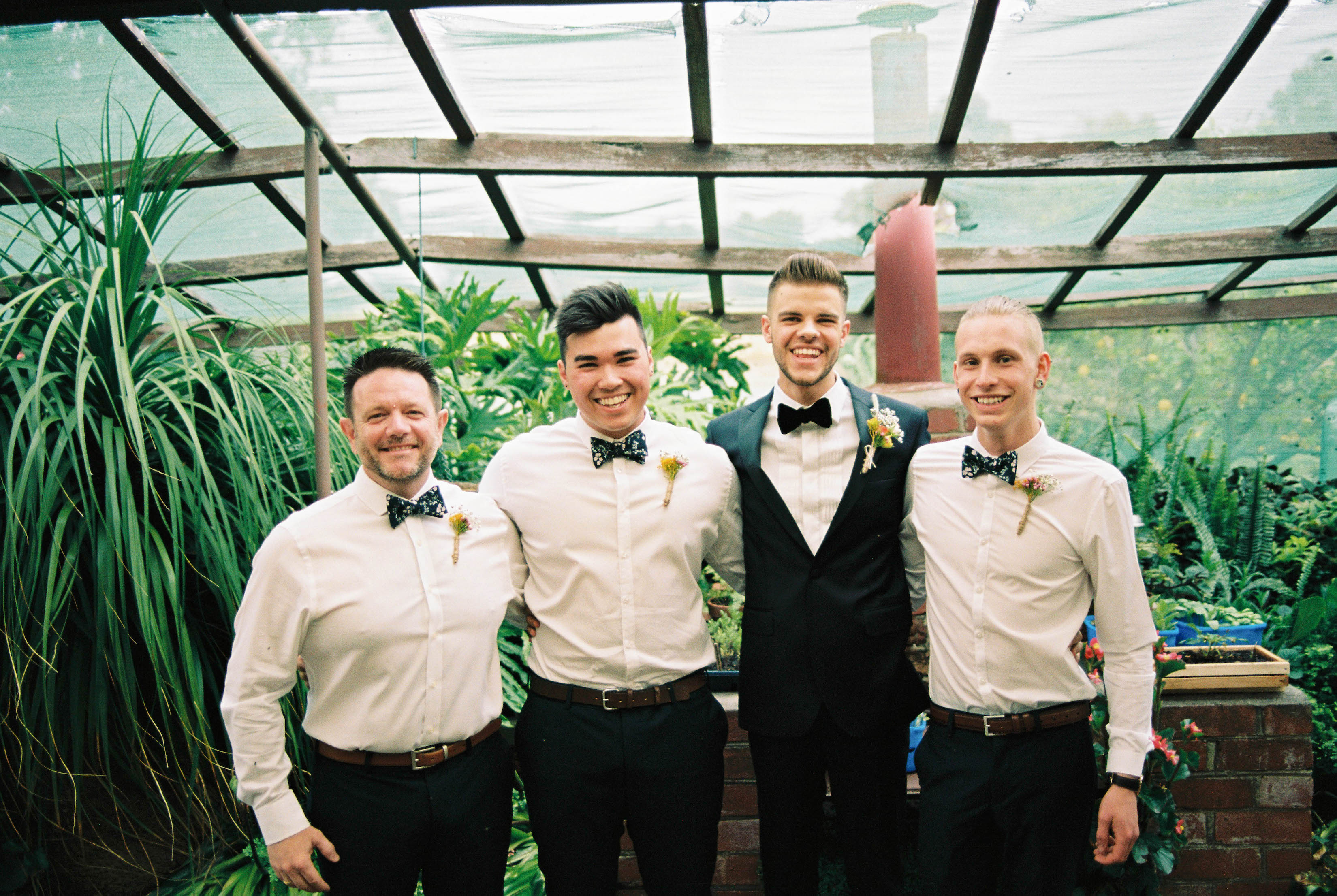 A photo of the groom and his groomsmen before his Down South Farm House Wedding Ceremony taken on film