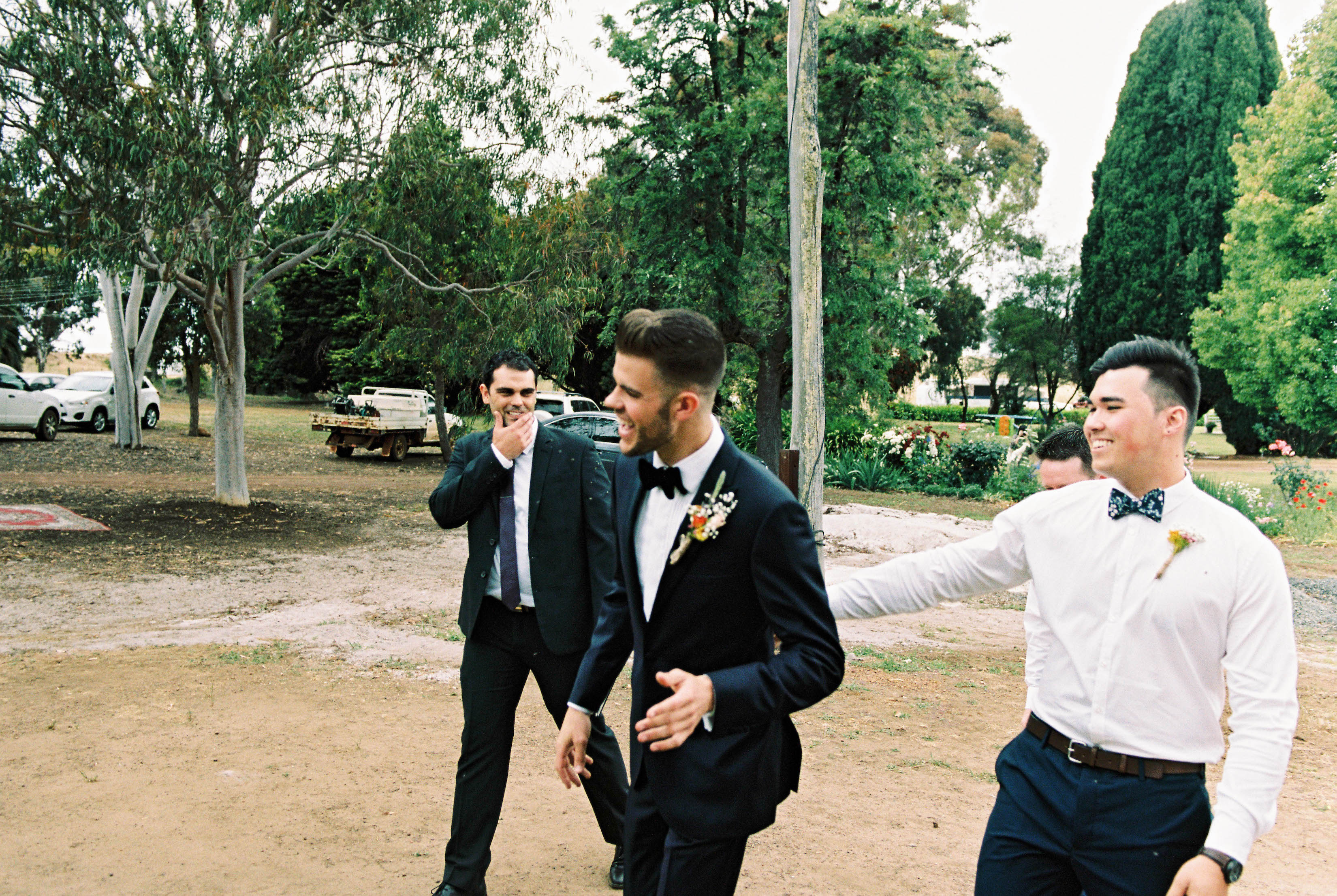 A photo of the groom and his groomsmen laughing on the way to his Down South Shearing Shed Wedding Ceremony