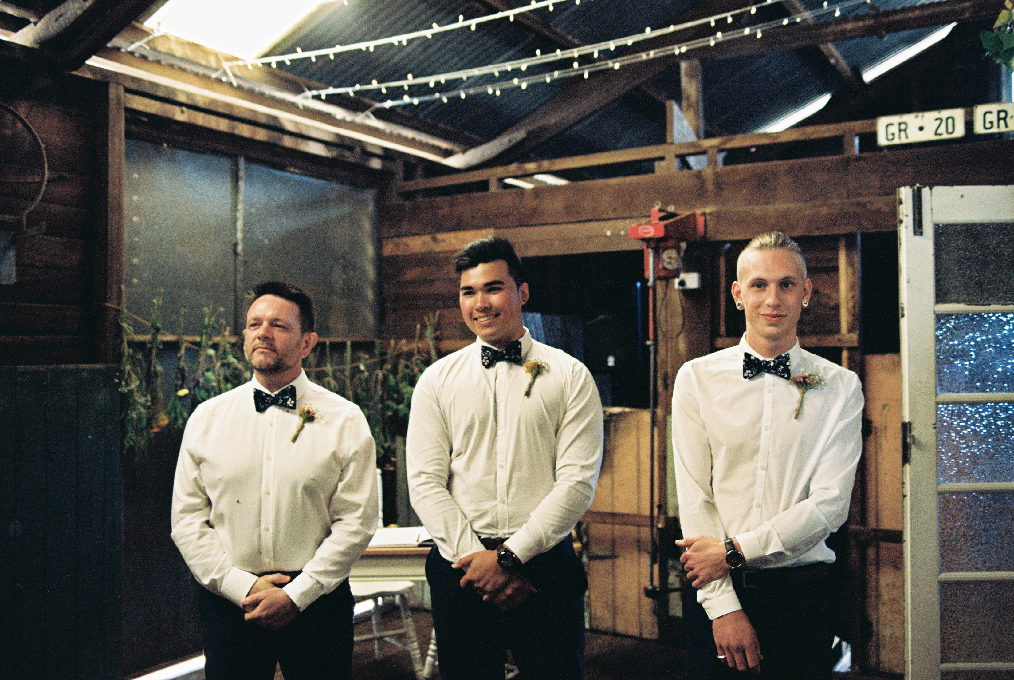 A photo of the groomsmen smiling at the beginning of the Shearing Shed Wedding Ceremony in the South West