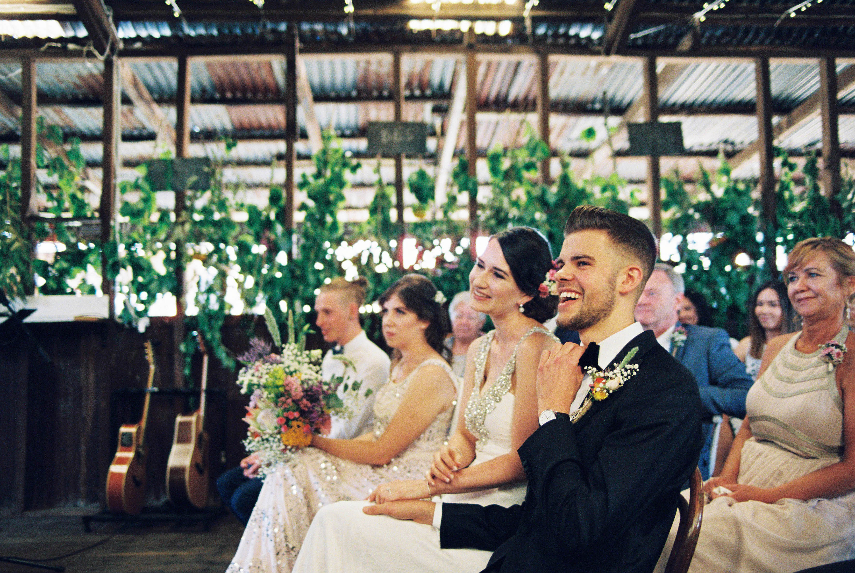A photo of the groom and bride laughing during their natural, authentic Australian country wedding, photographed by Destination Wedding Photographer, Rhianna May