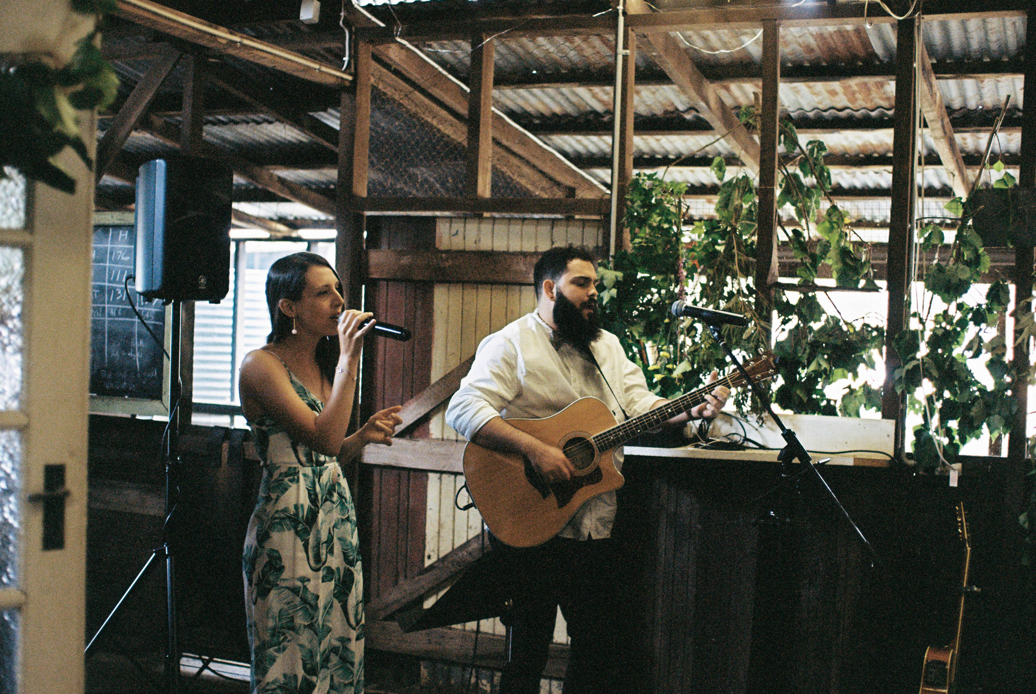 Live music plays during a barn wedding ceremony in Australia'a countryside.