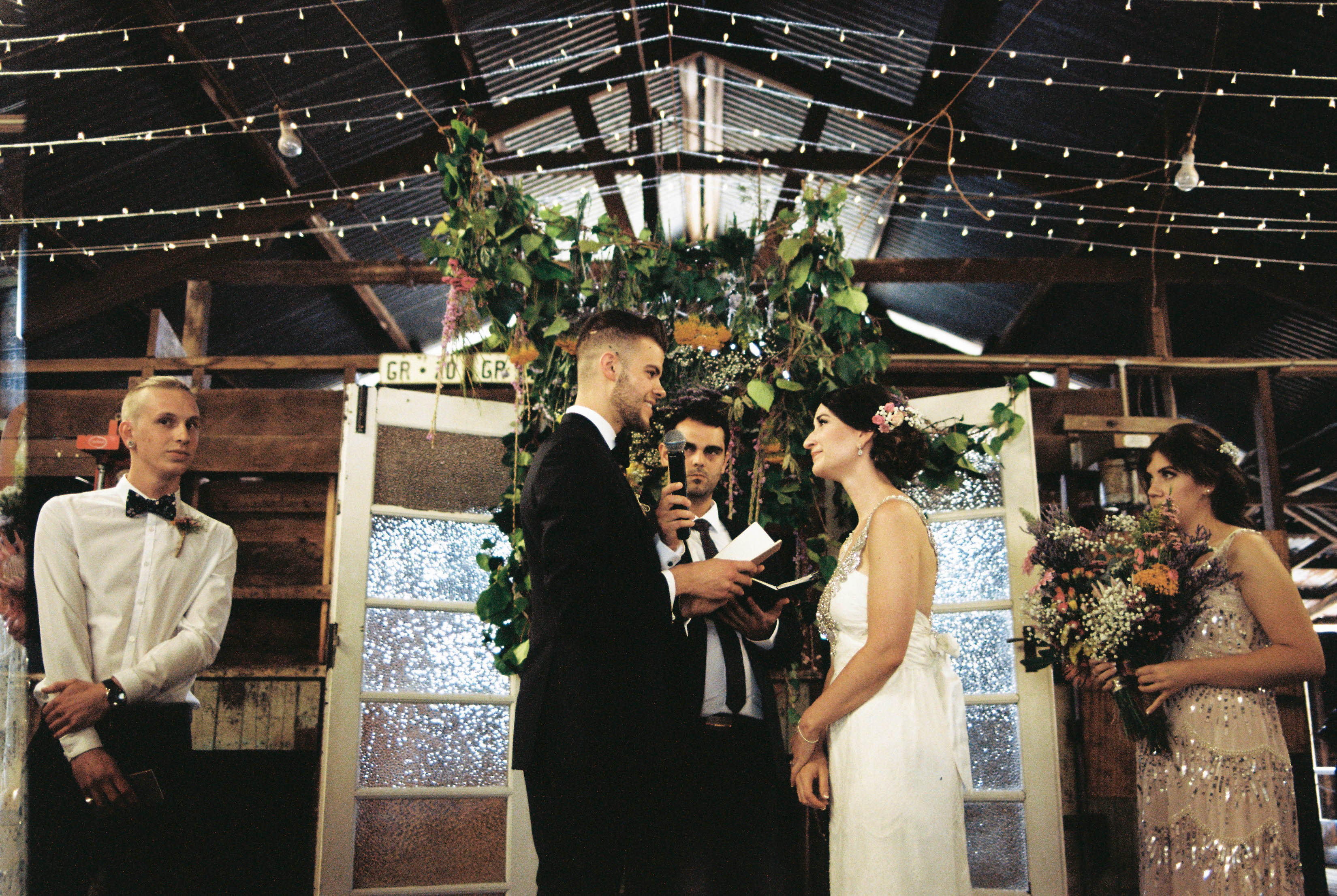 The groom and bride exchange vows, photographed on 35mm film by Australian and Italian Destination Wedding Photographer, Rhianna May