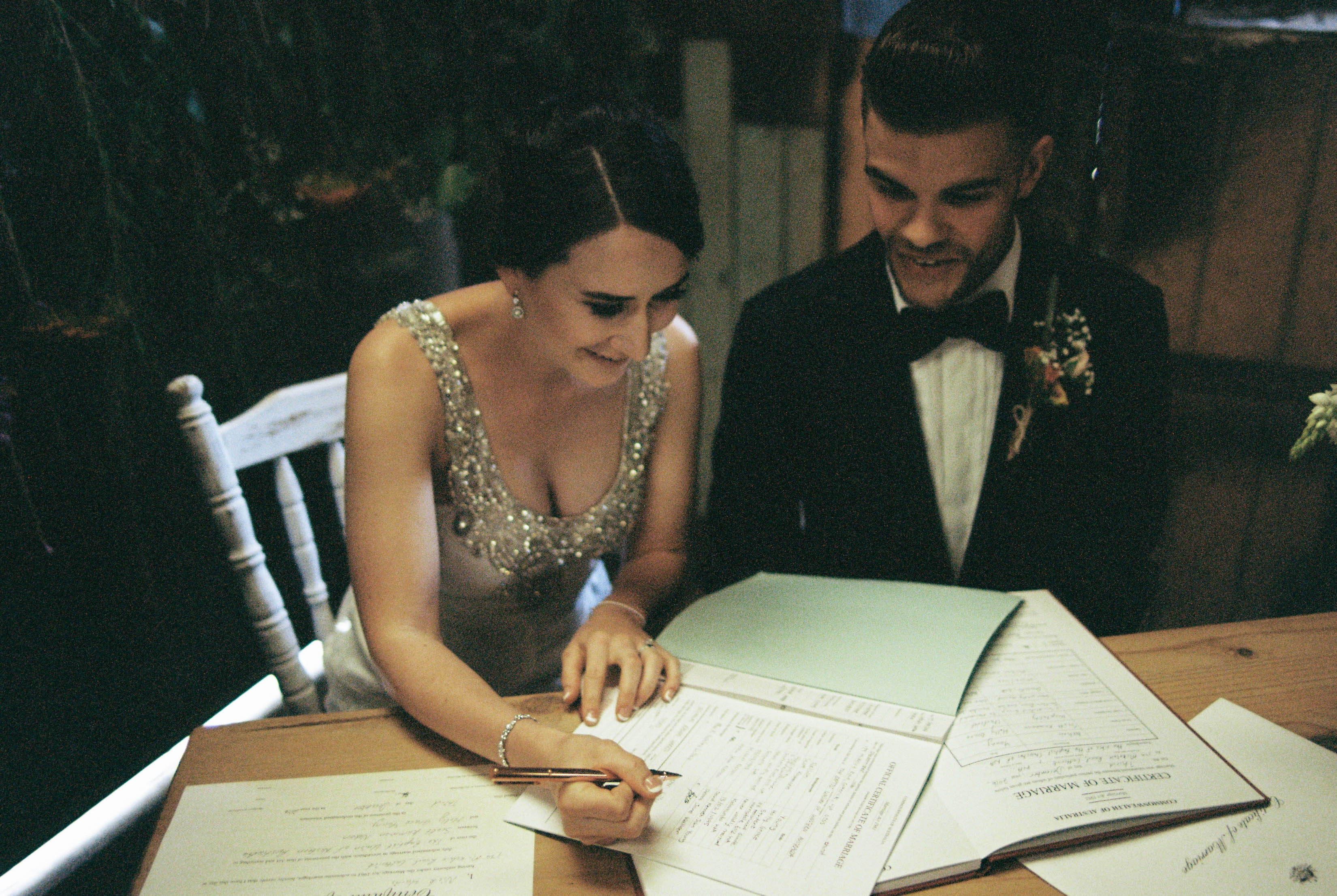 The bride and groom sign the wedding registry during their South West Country Wedding Ceremony
