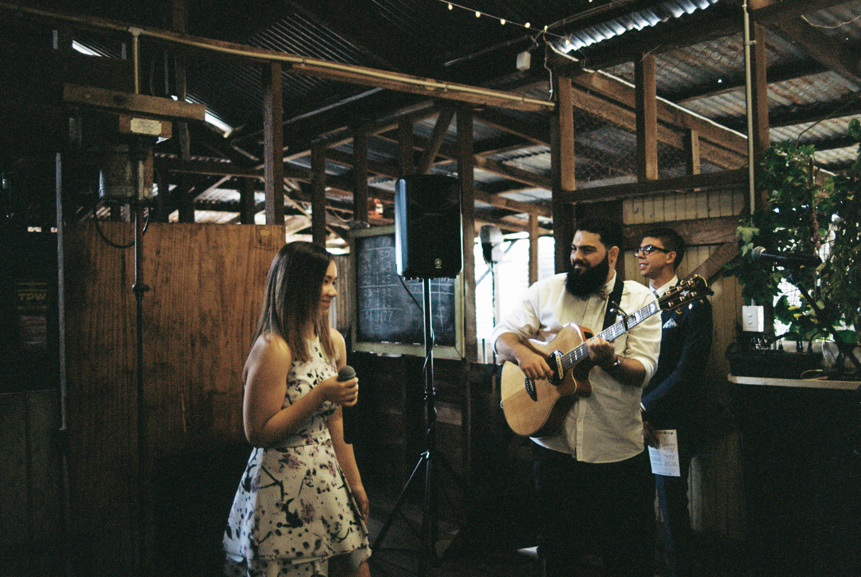 Musicians play a the end of a wedding ceremony in a the family farm's shearing shed