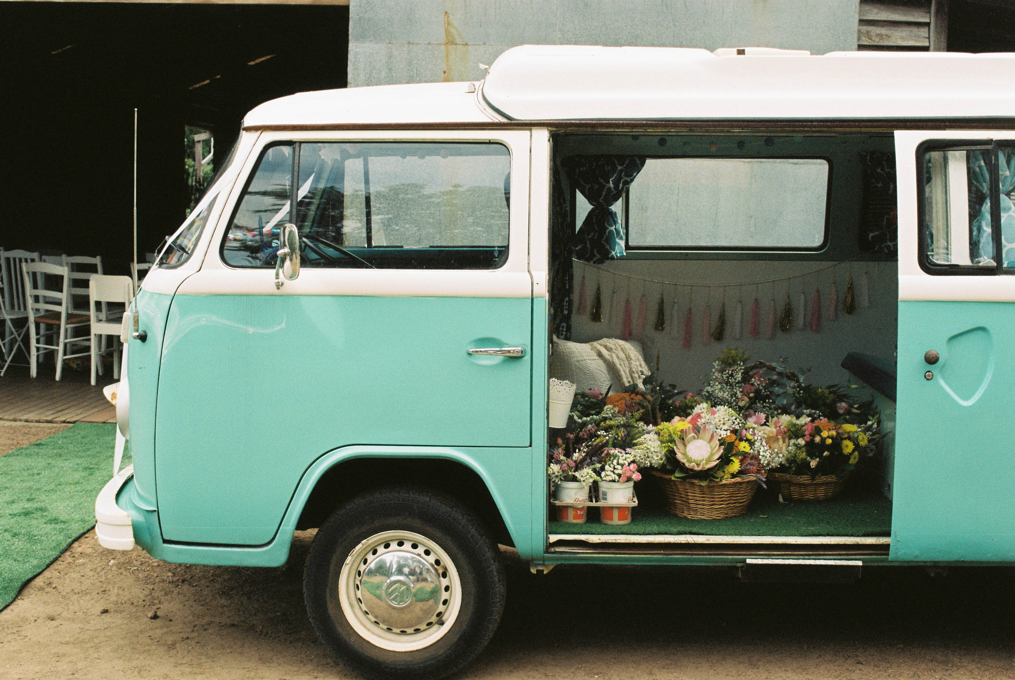 A photo of a Kombi Van filled with flowers the day of a wedding in Bridgetown, Western Australia