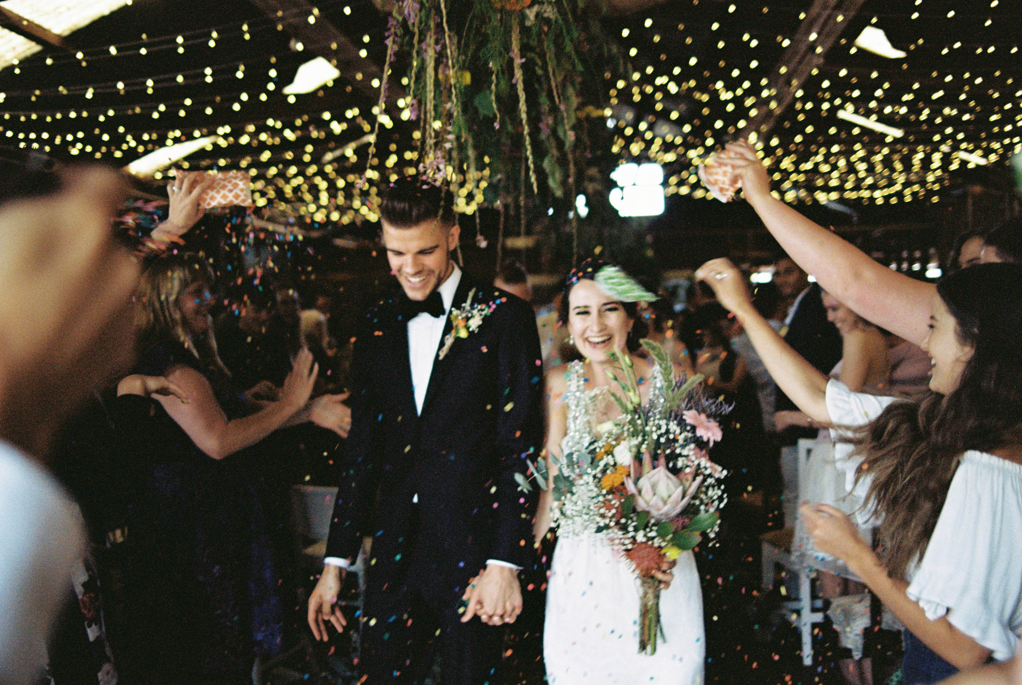 A photo of the confetti exit as the bride and groom walk down the aisle after their South West Wedding Ceremony