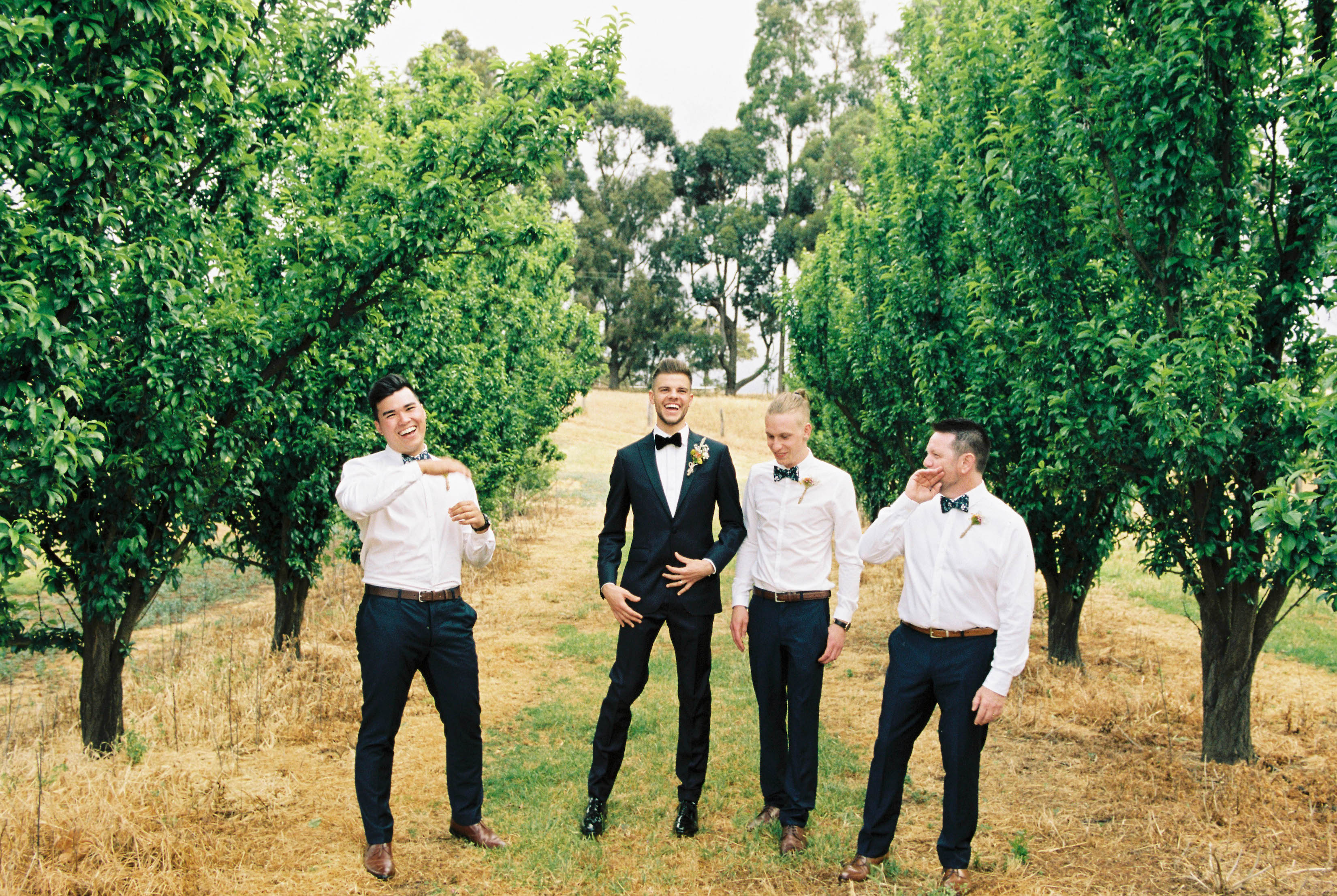 Authentic South West Wedding Photography of the groom and his groomsmen laughing together