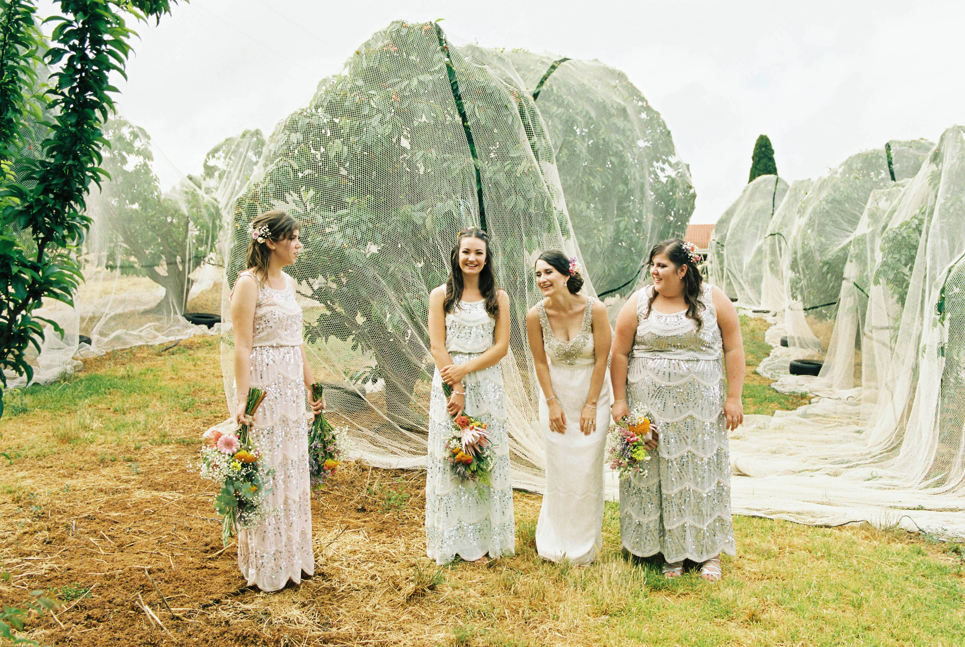 Photojournalist Wedding Photography of the bride and her bridesmaids laughing together