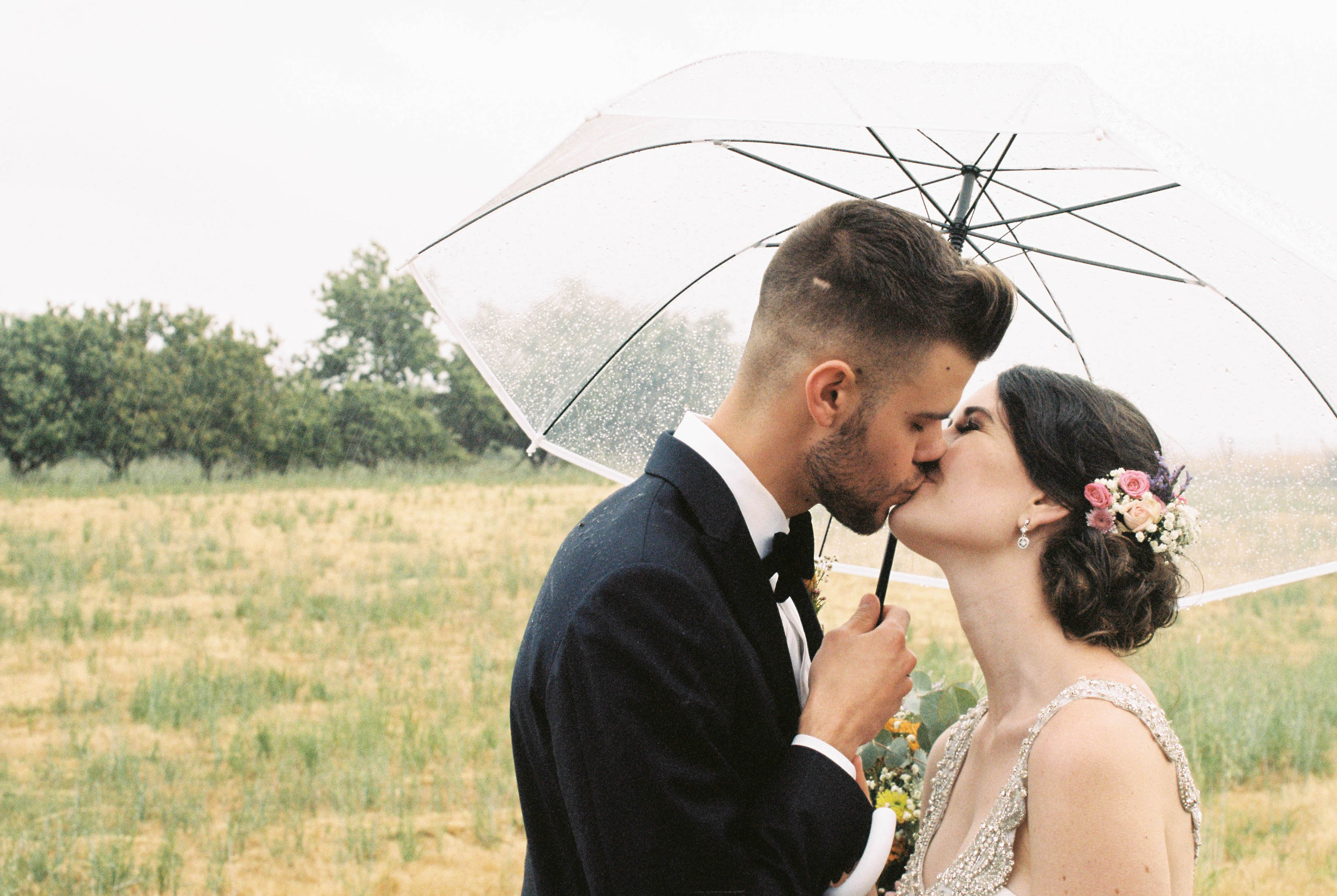 Authentic Wedding Photography of the Bride & Groom kissing on their wedding day