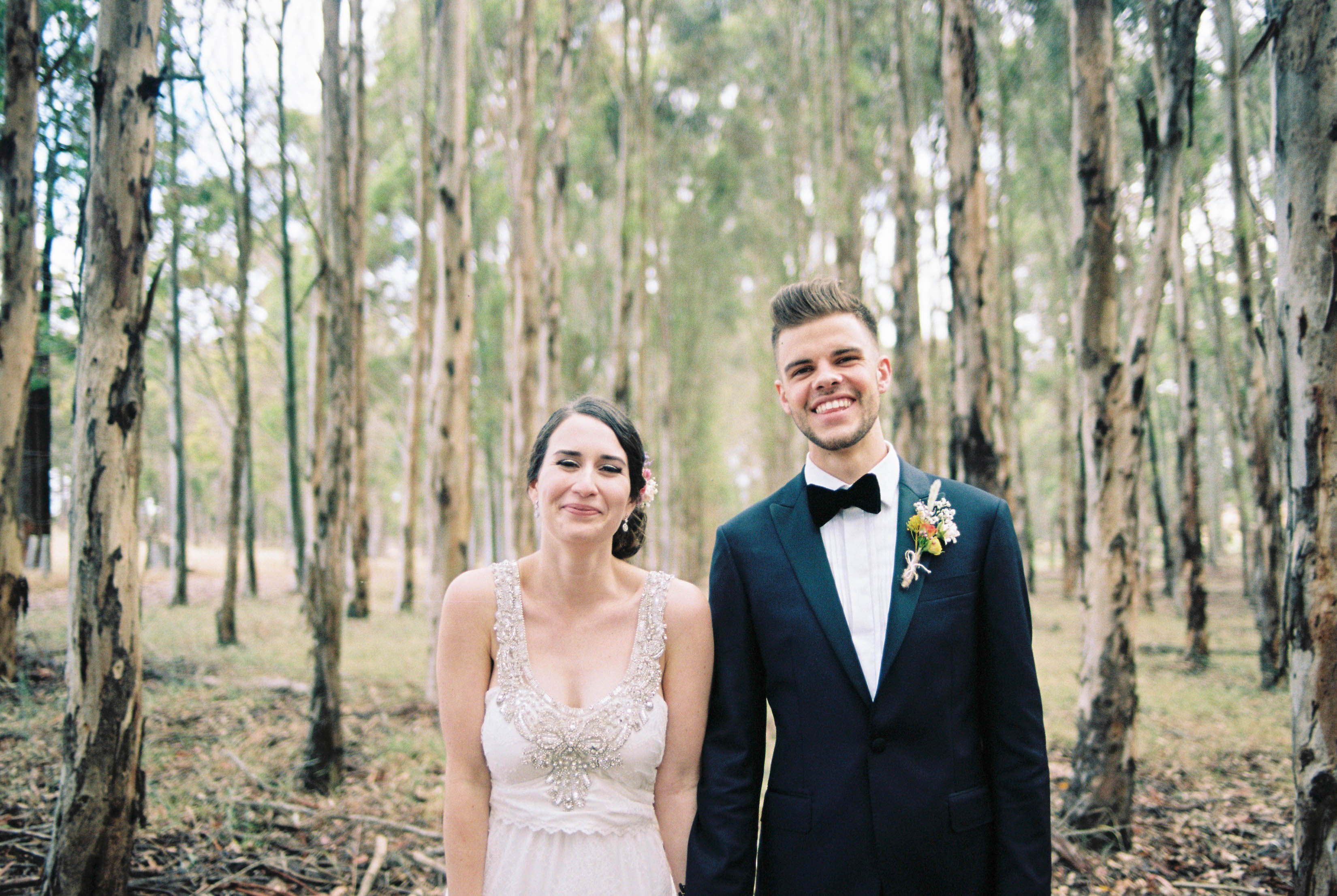 A photo of the bride & groom standing side-by-side and laughing at their Bridgetown wedding